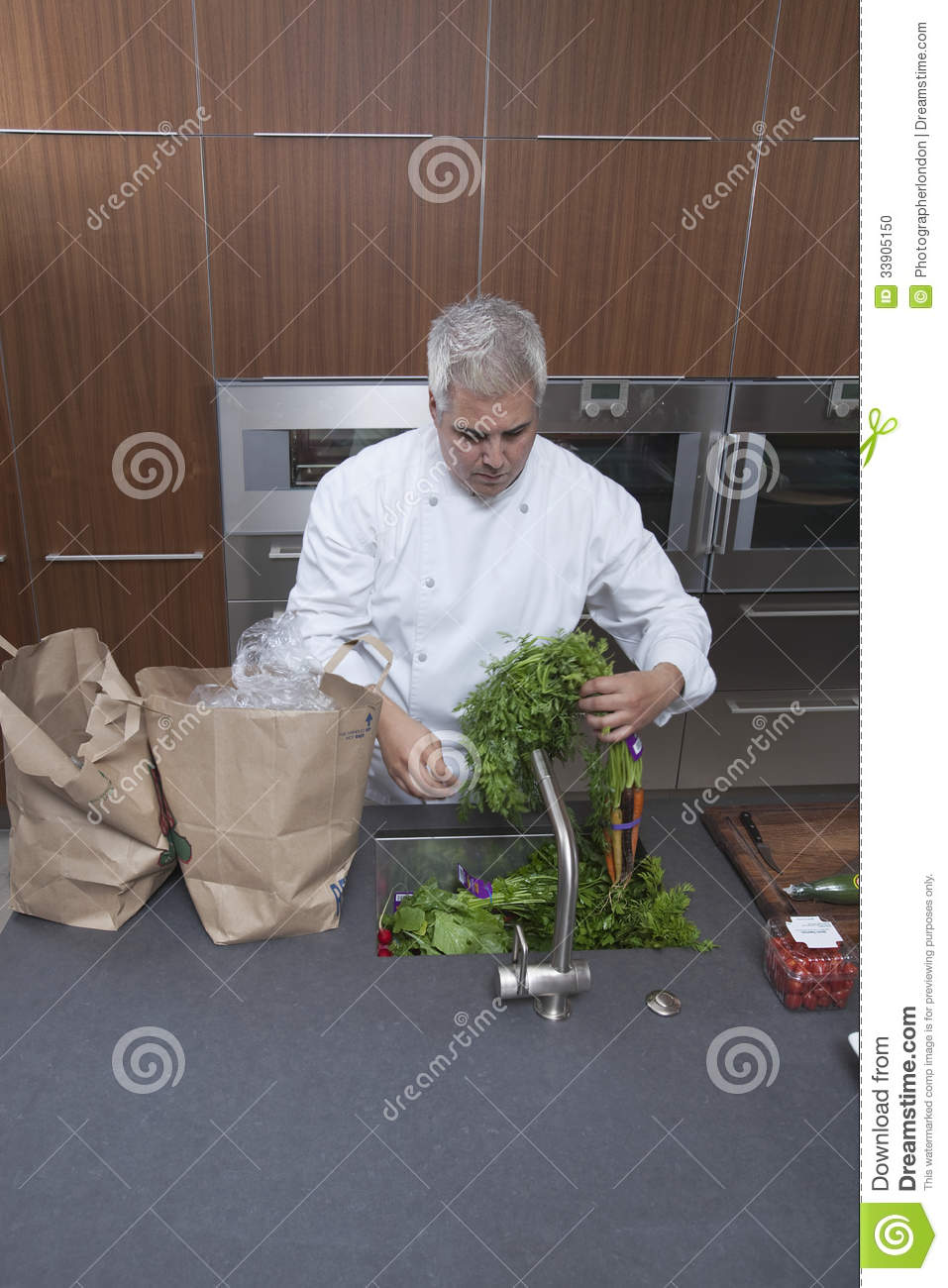 Chef Washing Vegetables In Kitchen Sink Stock Photo - Image: 33905150