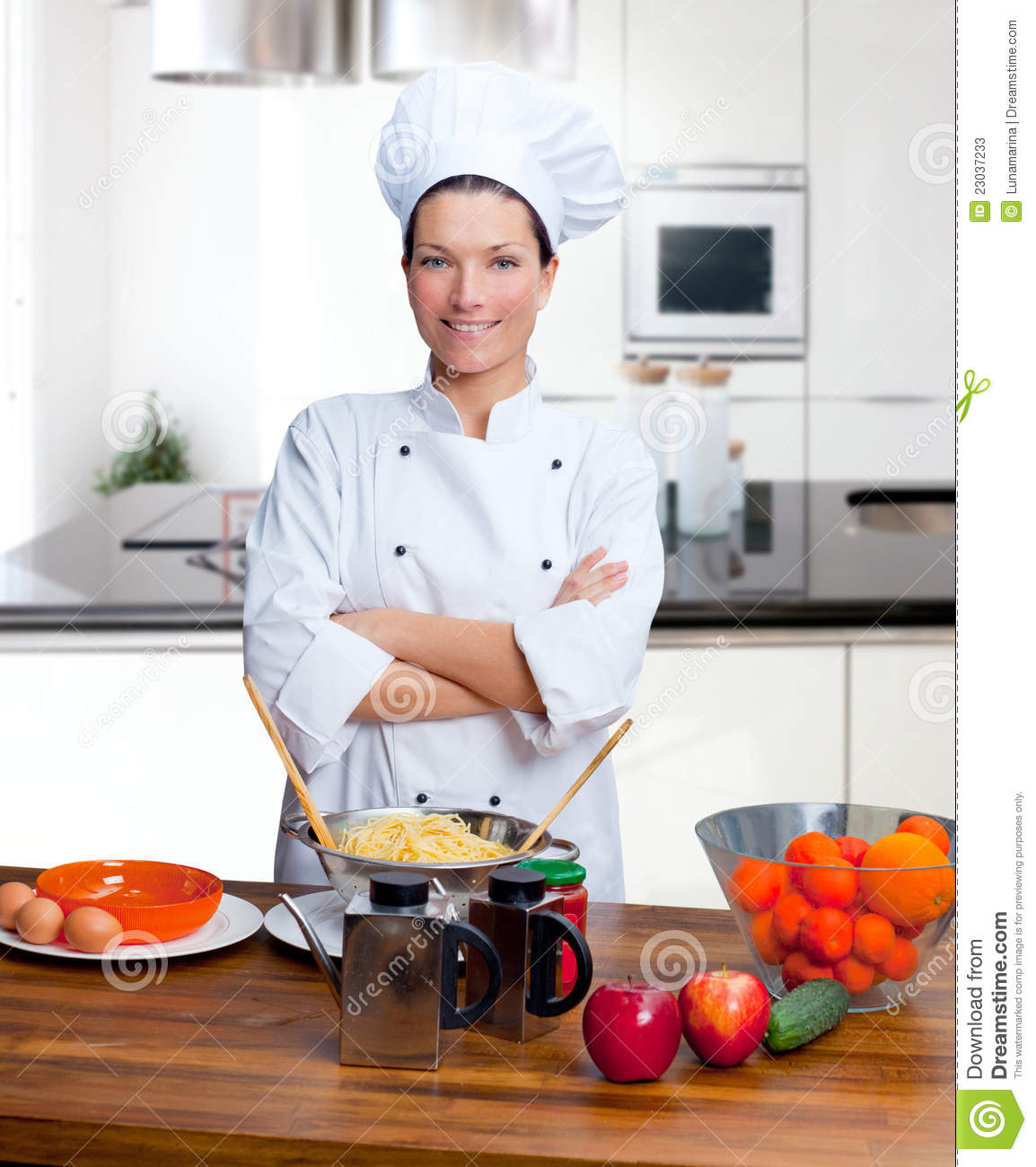 Women Kitchen: Chef Woman Portrait In The Kitchen Stock Image