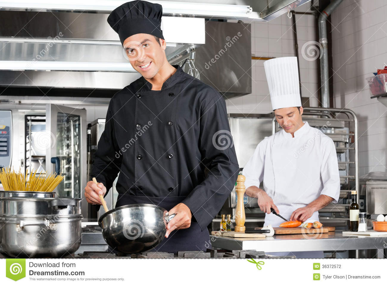 chefs cooking food in kitchen stock photography image 36372572. Black Bedroom Furniture Sets. Home Design Ideas