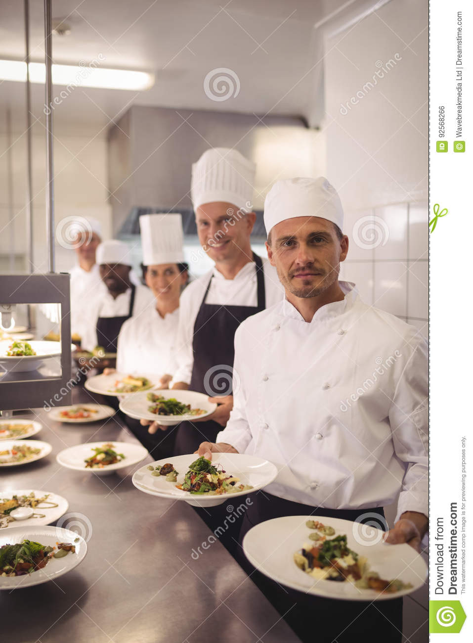 Chefs presenting food plates