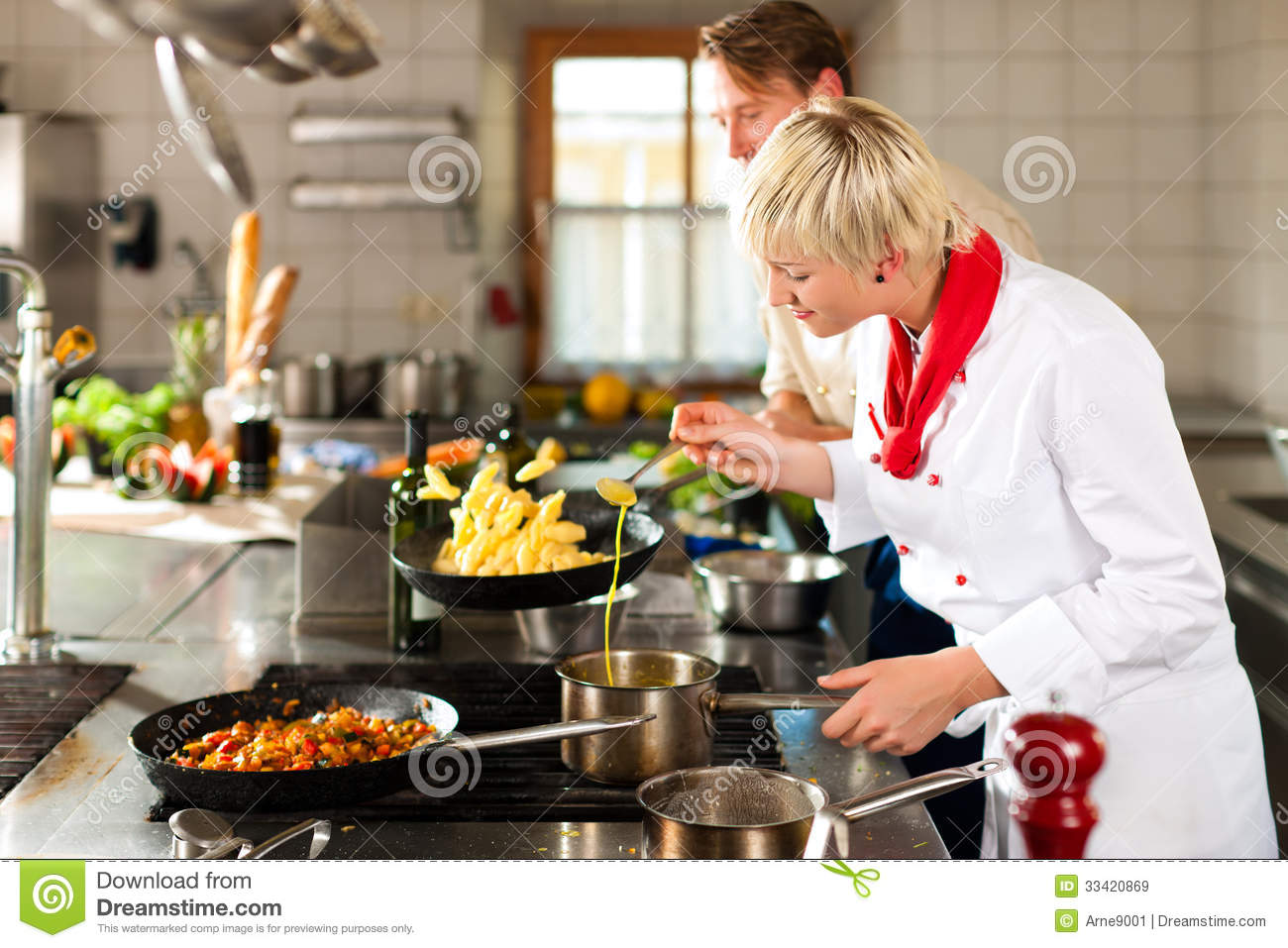 chefs in teamwork men and women in a restaurant or hotel kitchen