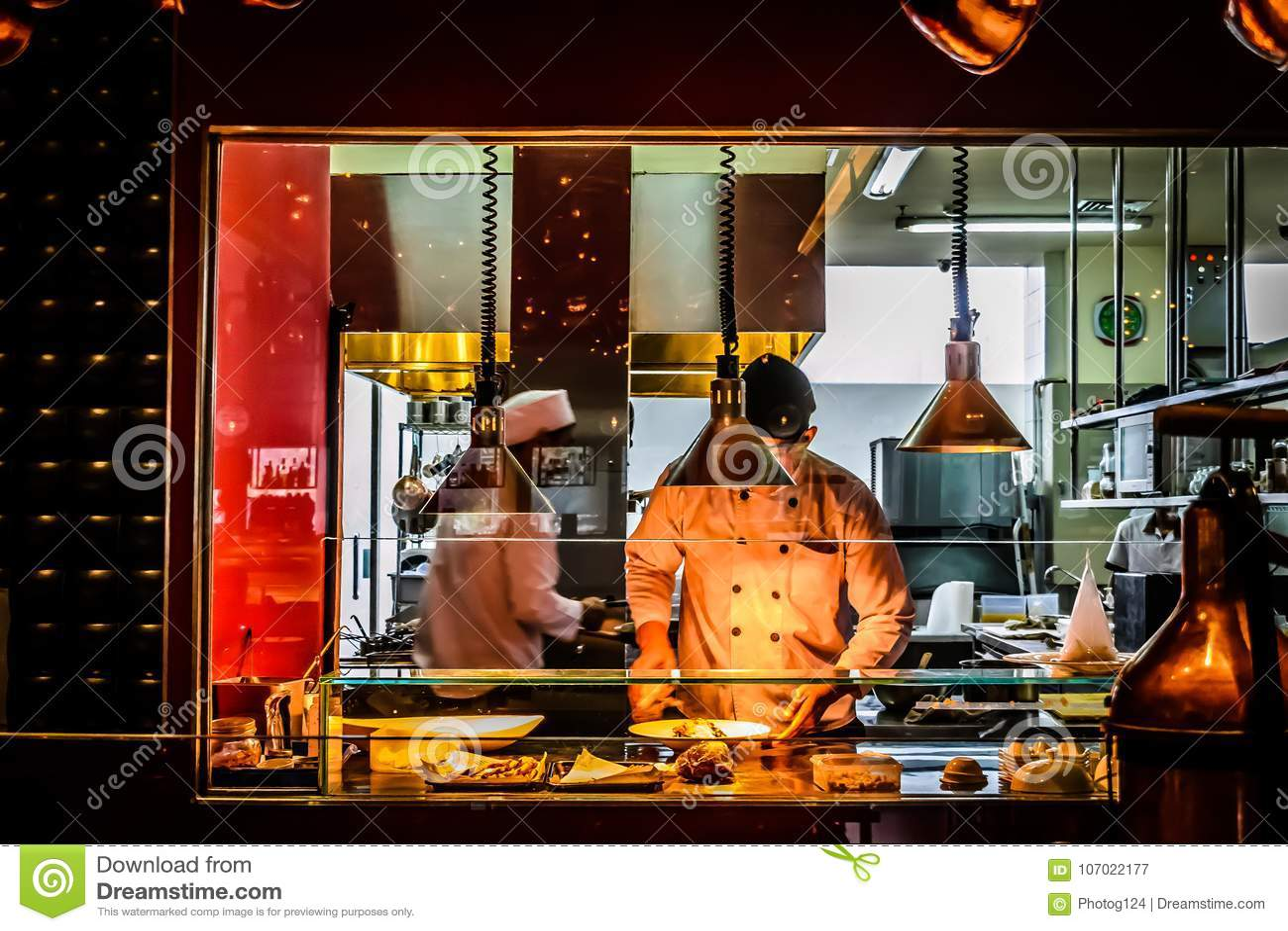 Chefs Working In Italian Restaurant Kitchen Editorial Photography