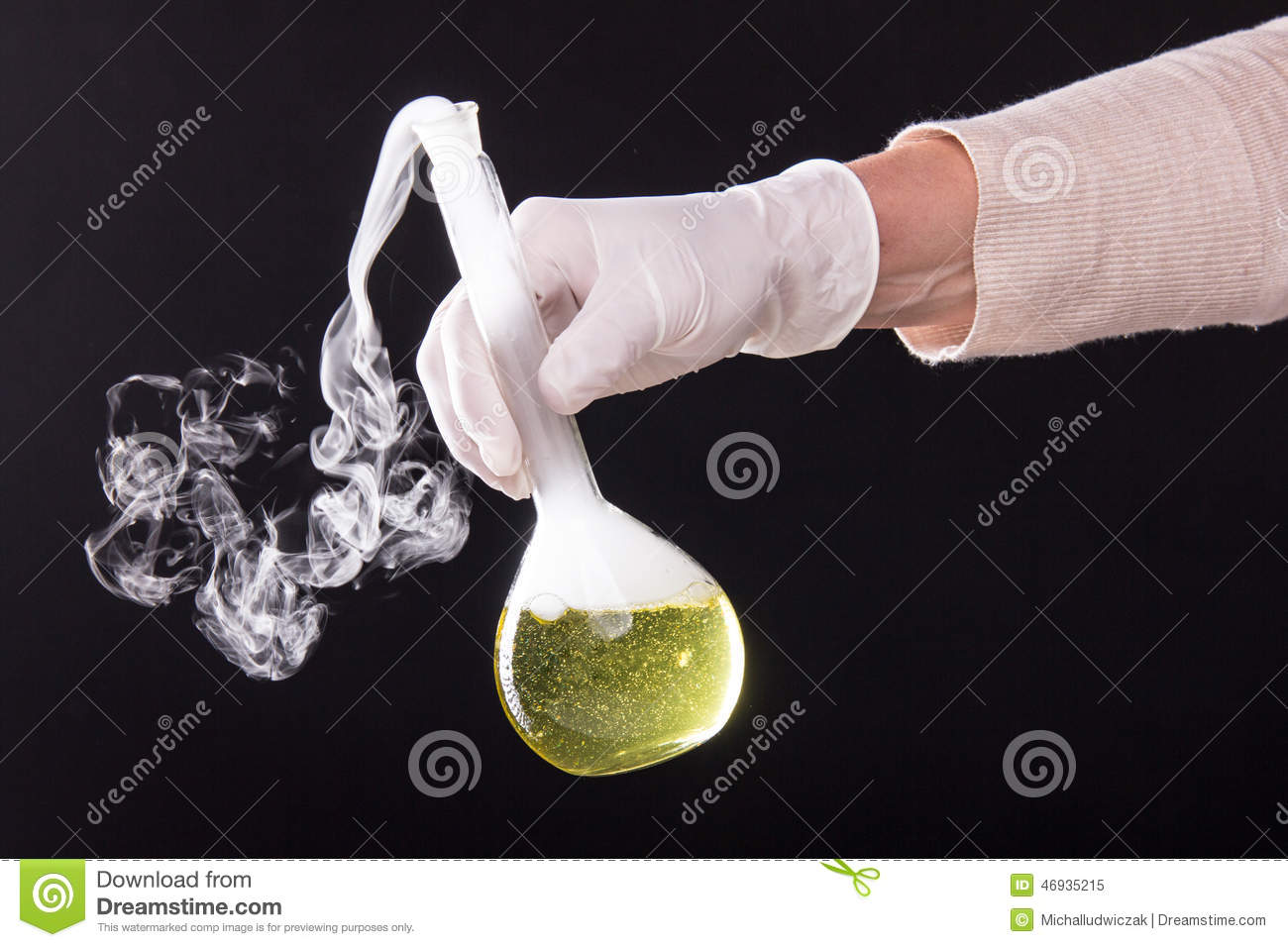 Chemical reaction in volumetric flask glass kept in the hands of