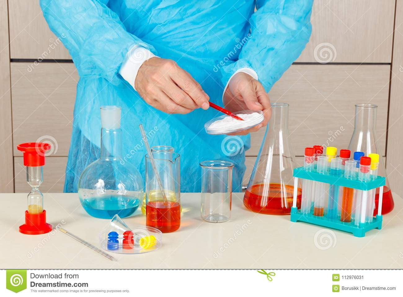 Chemist doing chemical experiments in laboratory