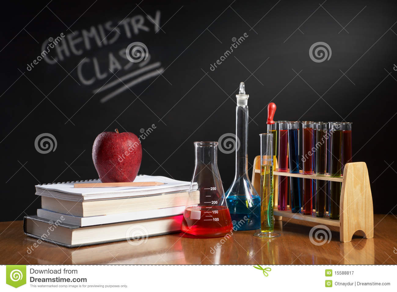 ... class concept with red apple on pile of books and chemical solution