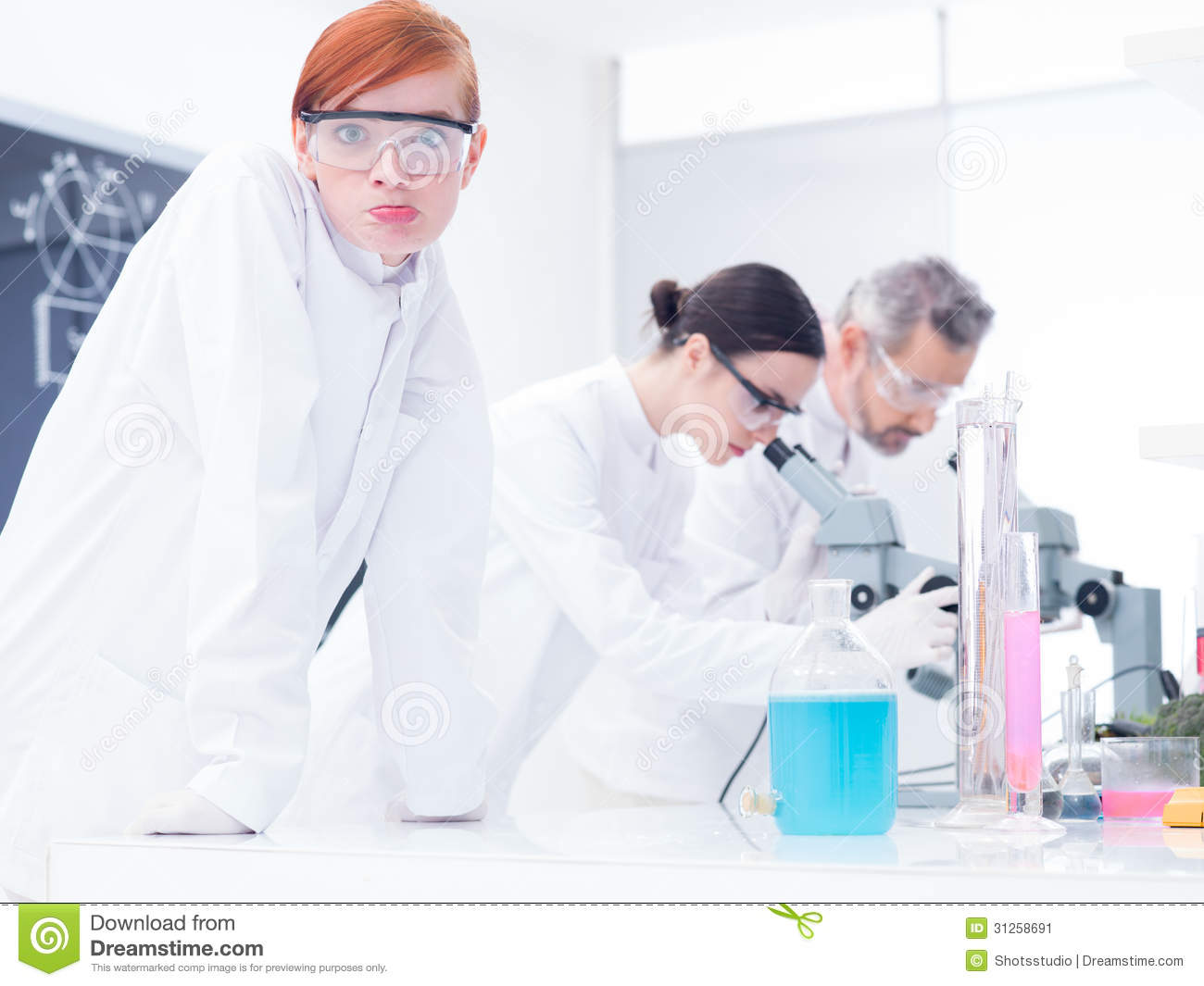 Close-up of a beautiful girl student in a chemistry lab looking ...