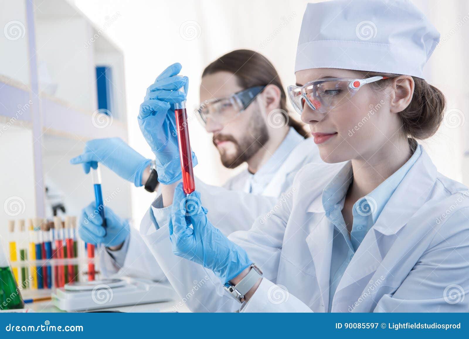 Chemists making experiment