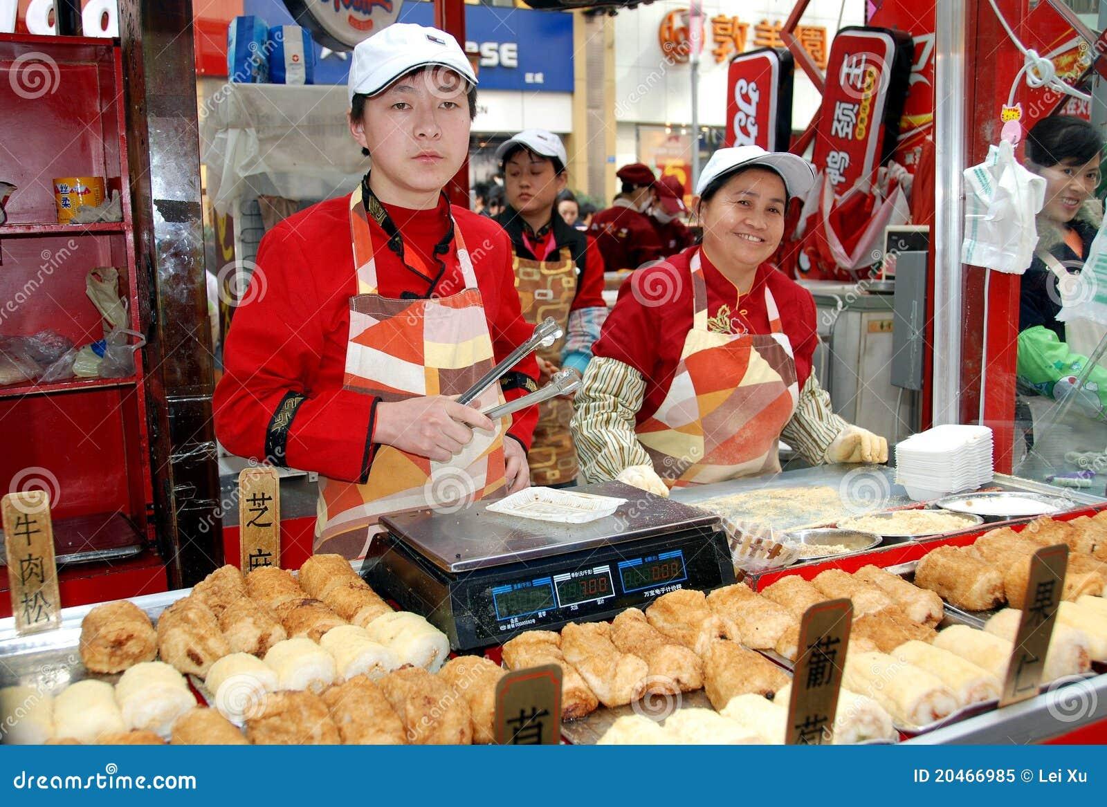 Chengdu, China: Vendedores de alimento de la calle de Chun XI