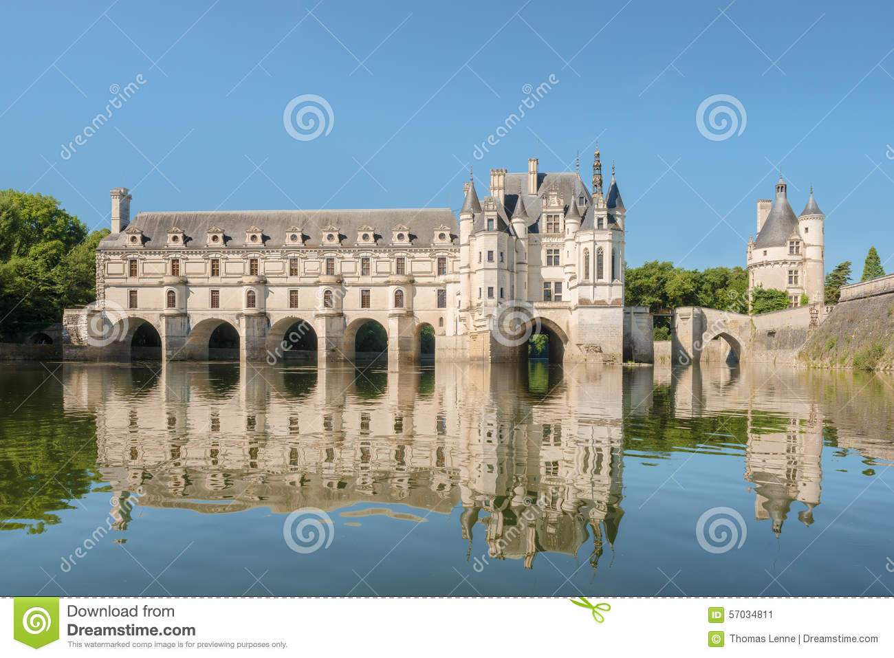 Chenonceau castle built over the cher river loire valley france view from the river on gradient blue sky background