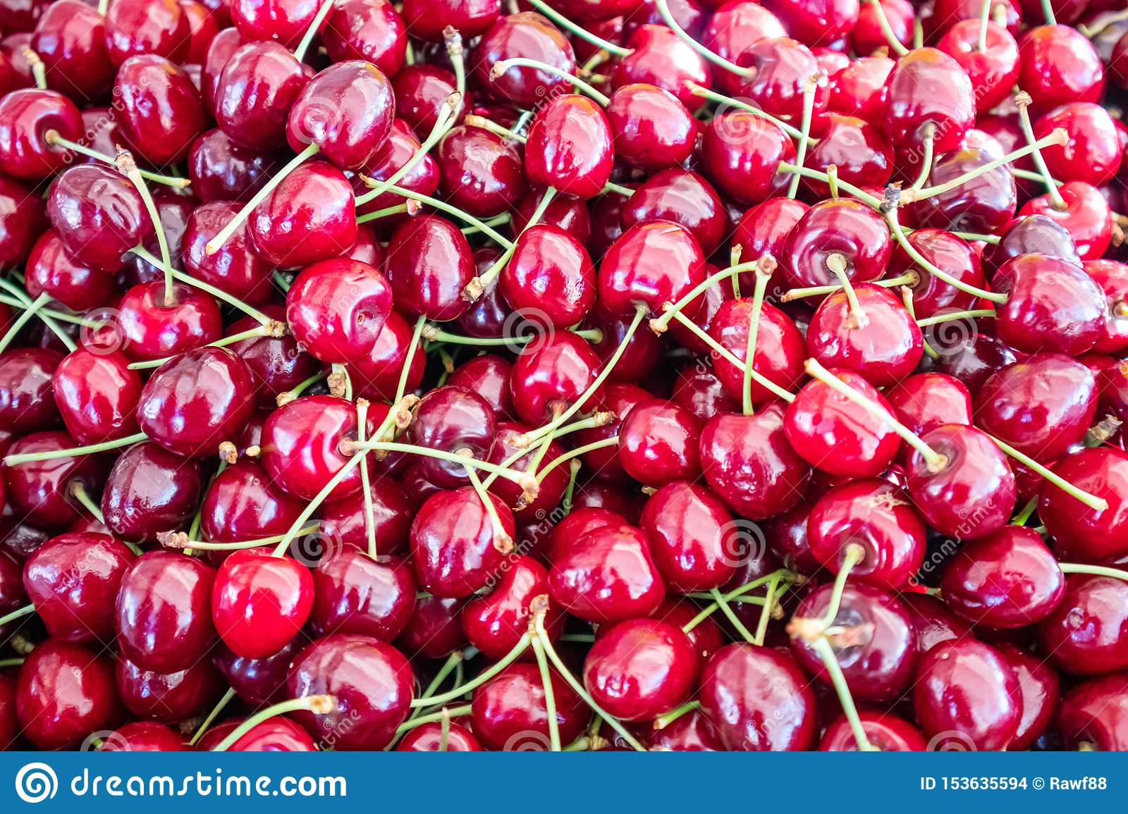Cherries Pile At Farmers Market Background Texture Stock