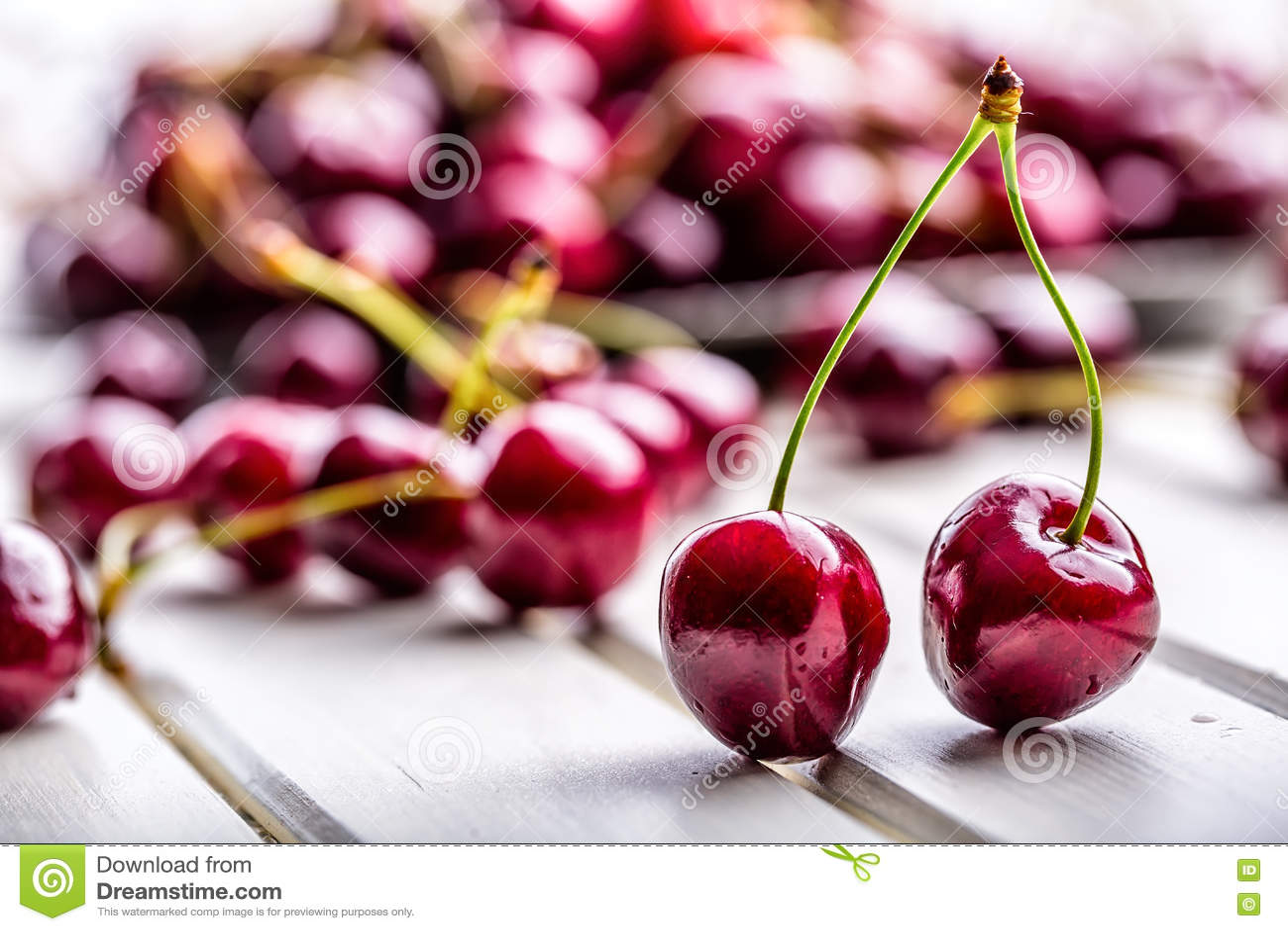 Cherries. Sweet Cherries. Fresh Cherries. Ripe cherries on wooden concrete table - board