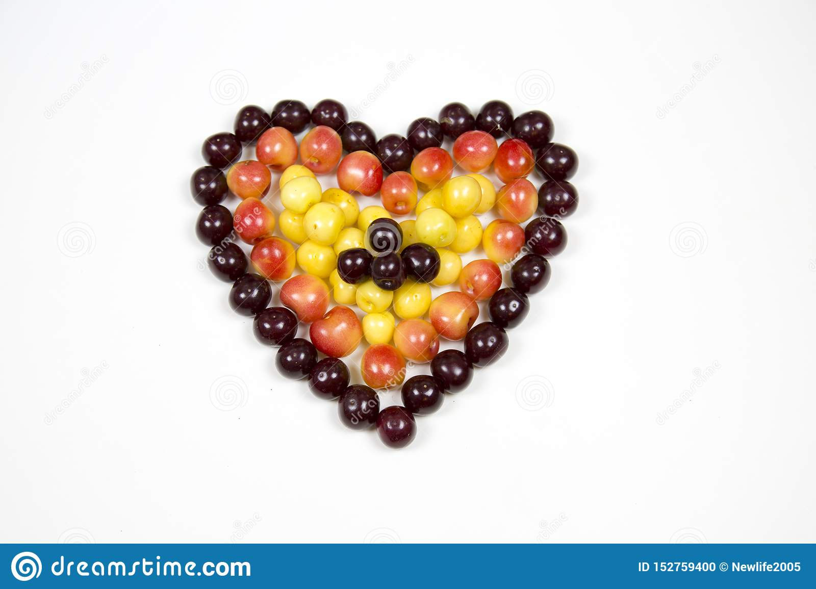 Cherry berries cherries in the form of a heart of red pink yellow isolated on a white background, a place for the text of the conc