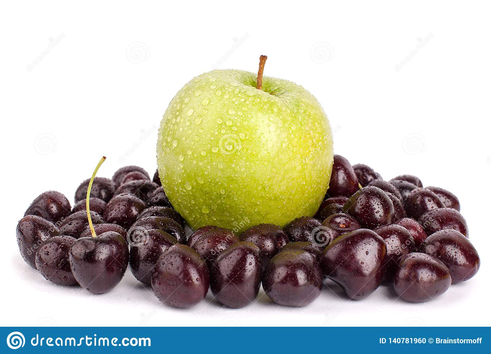 Cherry berries and one big green apple on white background isolated close up macro