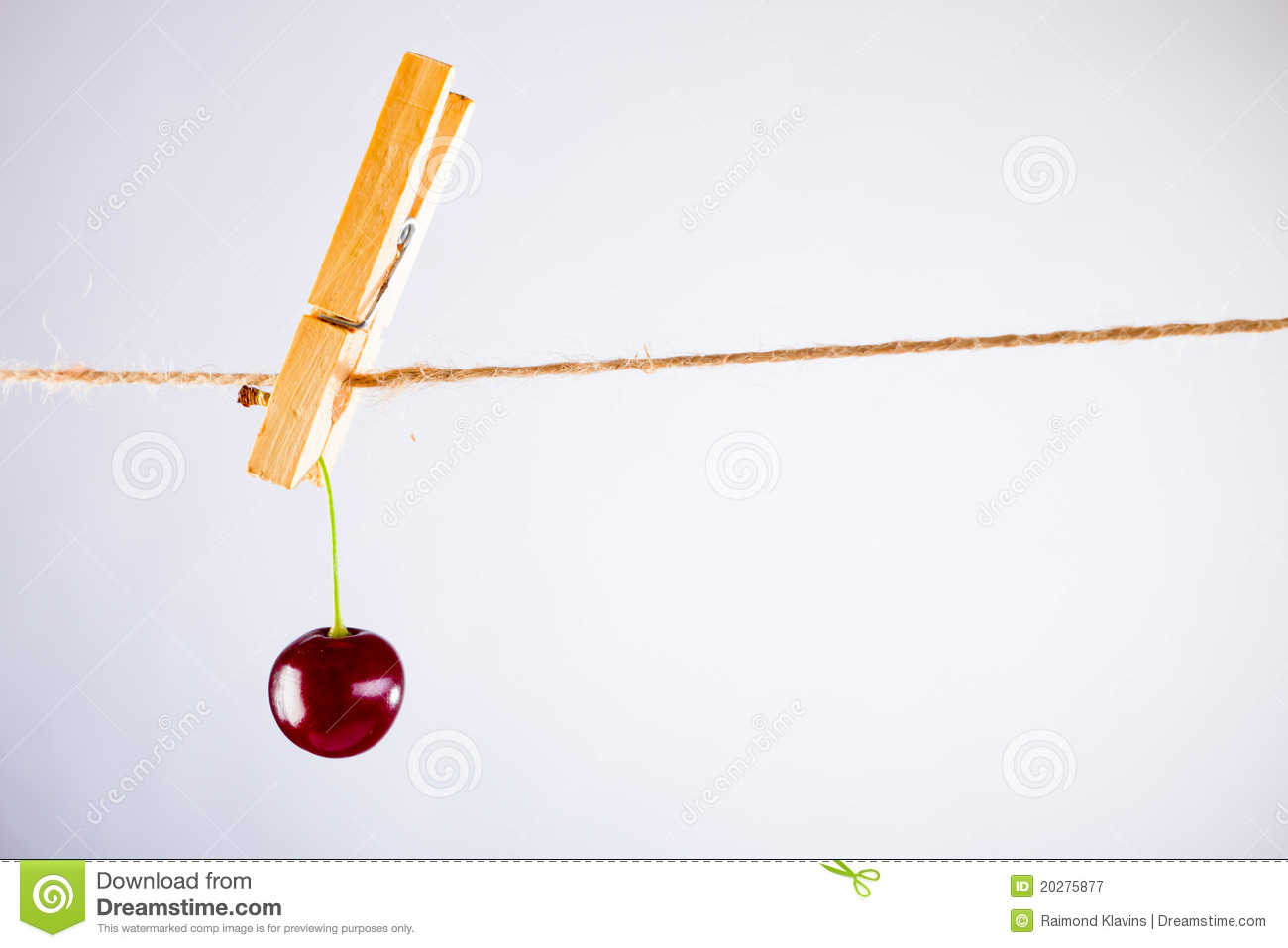 Cherry and rope on white with clamp
