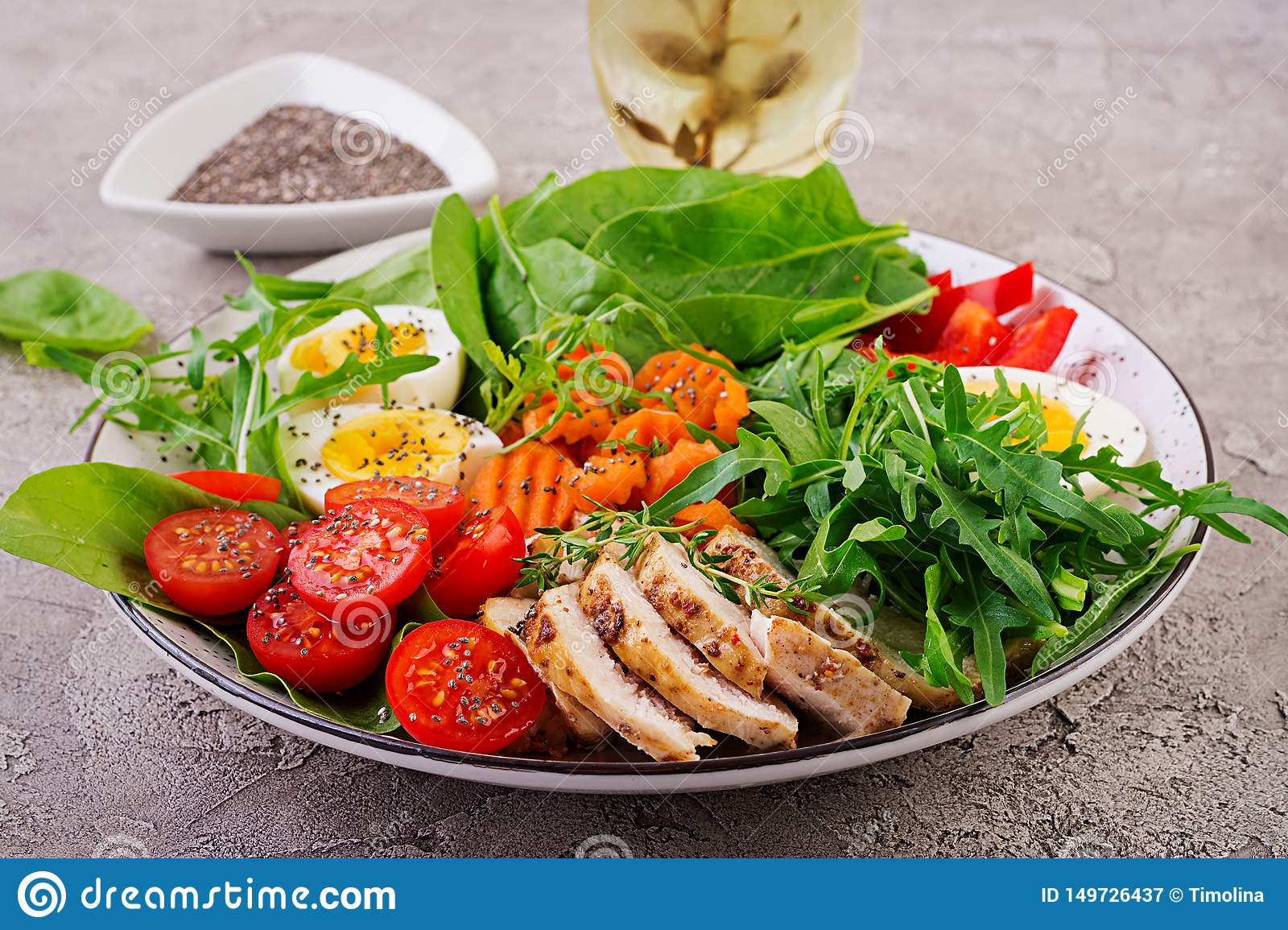 Cherry tomatoes, chicken breast, eggs, carrot, salad with arugula