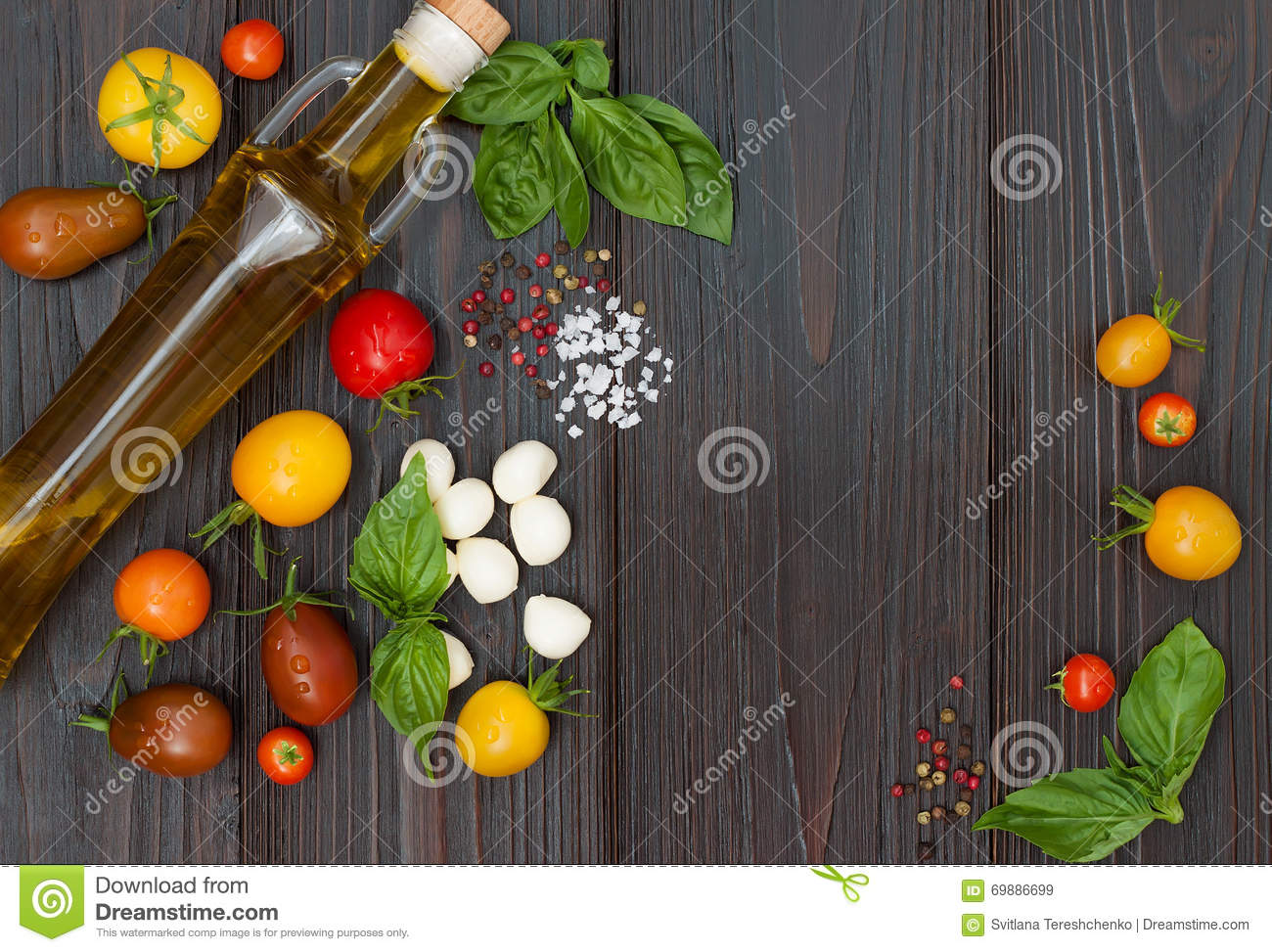 Cherry tomatoes, mozzarella, basil leaves, spices and olive oil from above. Italian caprese salad recipe ingredients