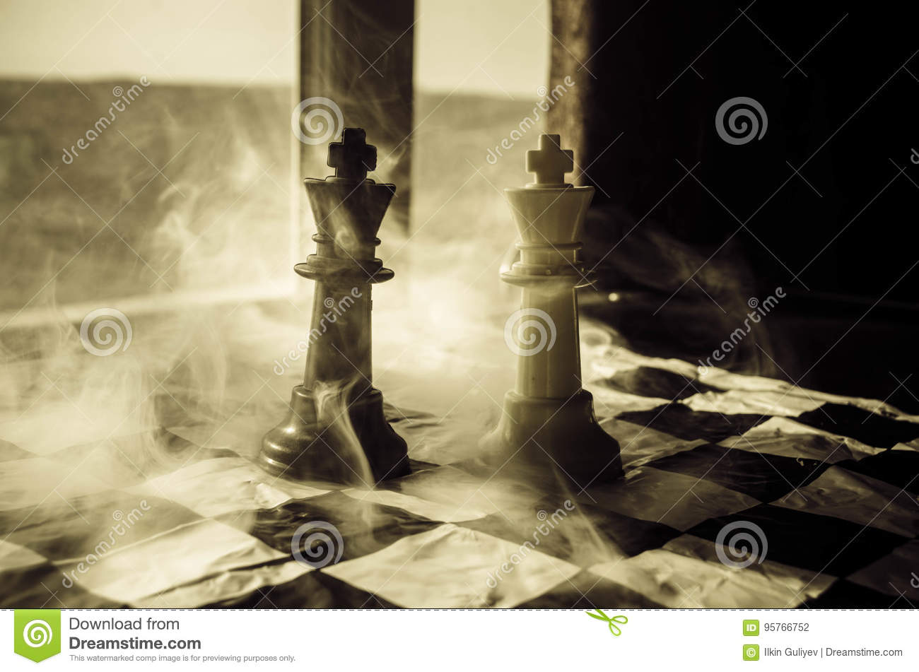 chess board game concept of business ideas and competition and strategy ideas concep. Chess figures on a dark background with smok
