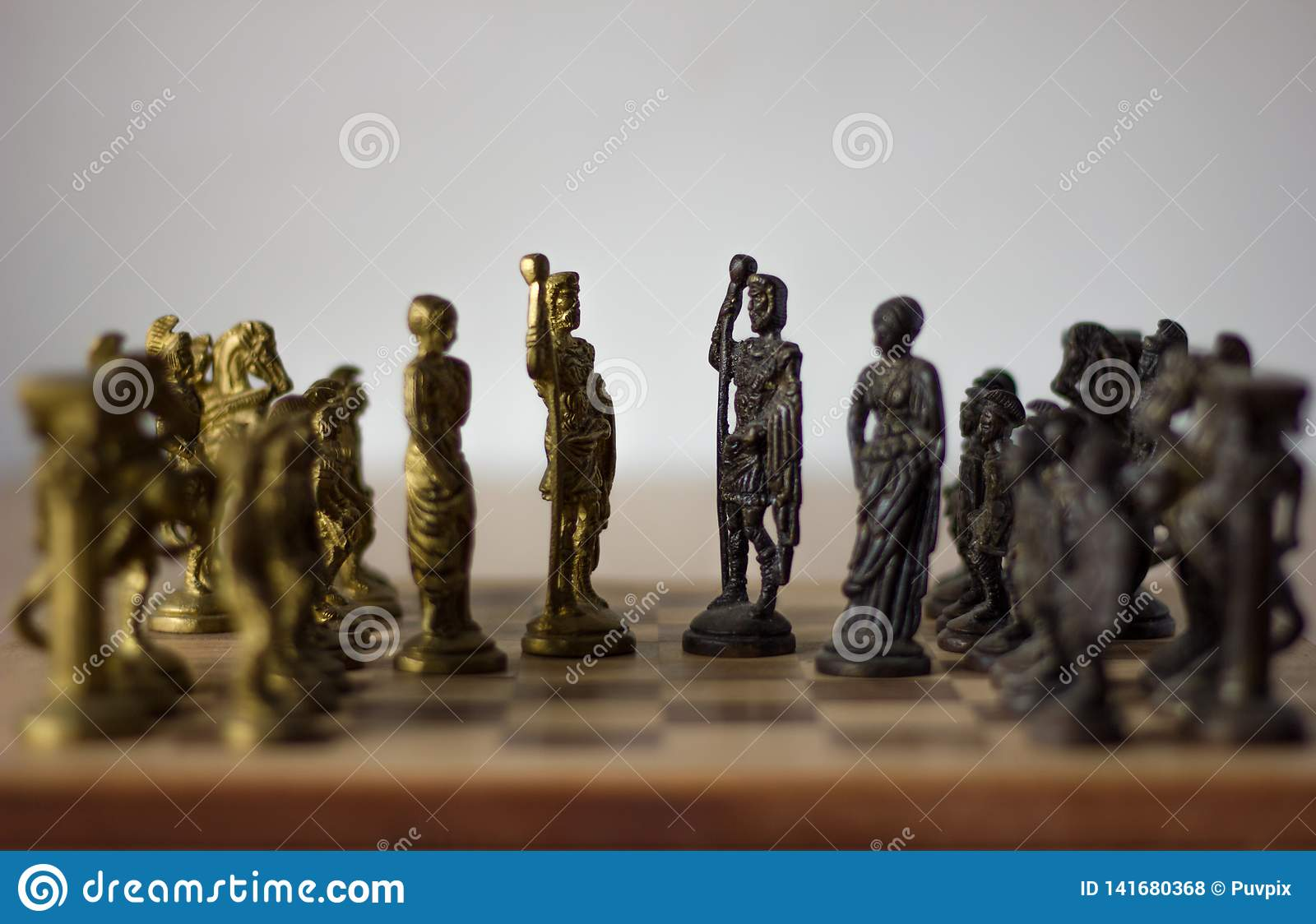 Chess board game, with kings and queens discussing for compromise, peace talks with their army behind