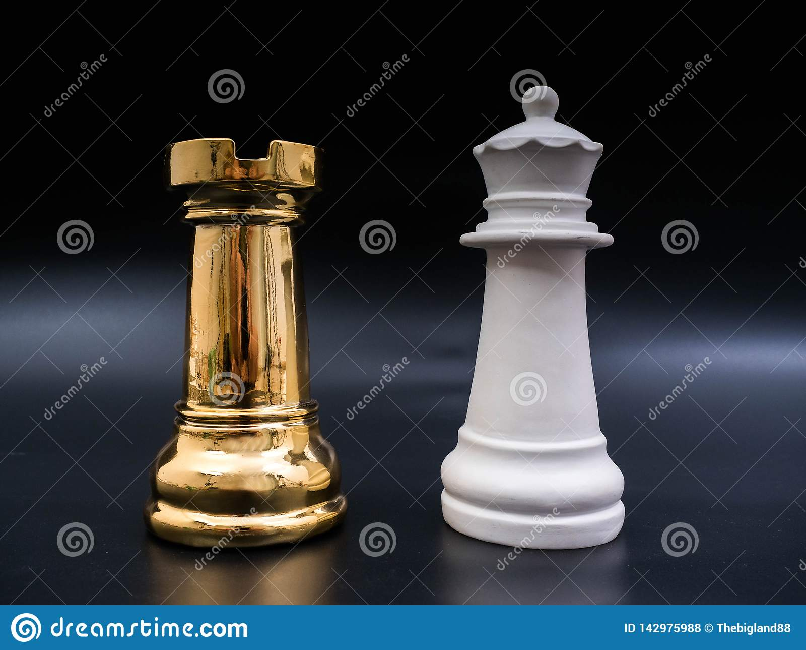 Chess leadership concept with gold and white chess isolated in black background. Chess concept save the strategy