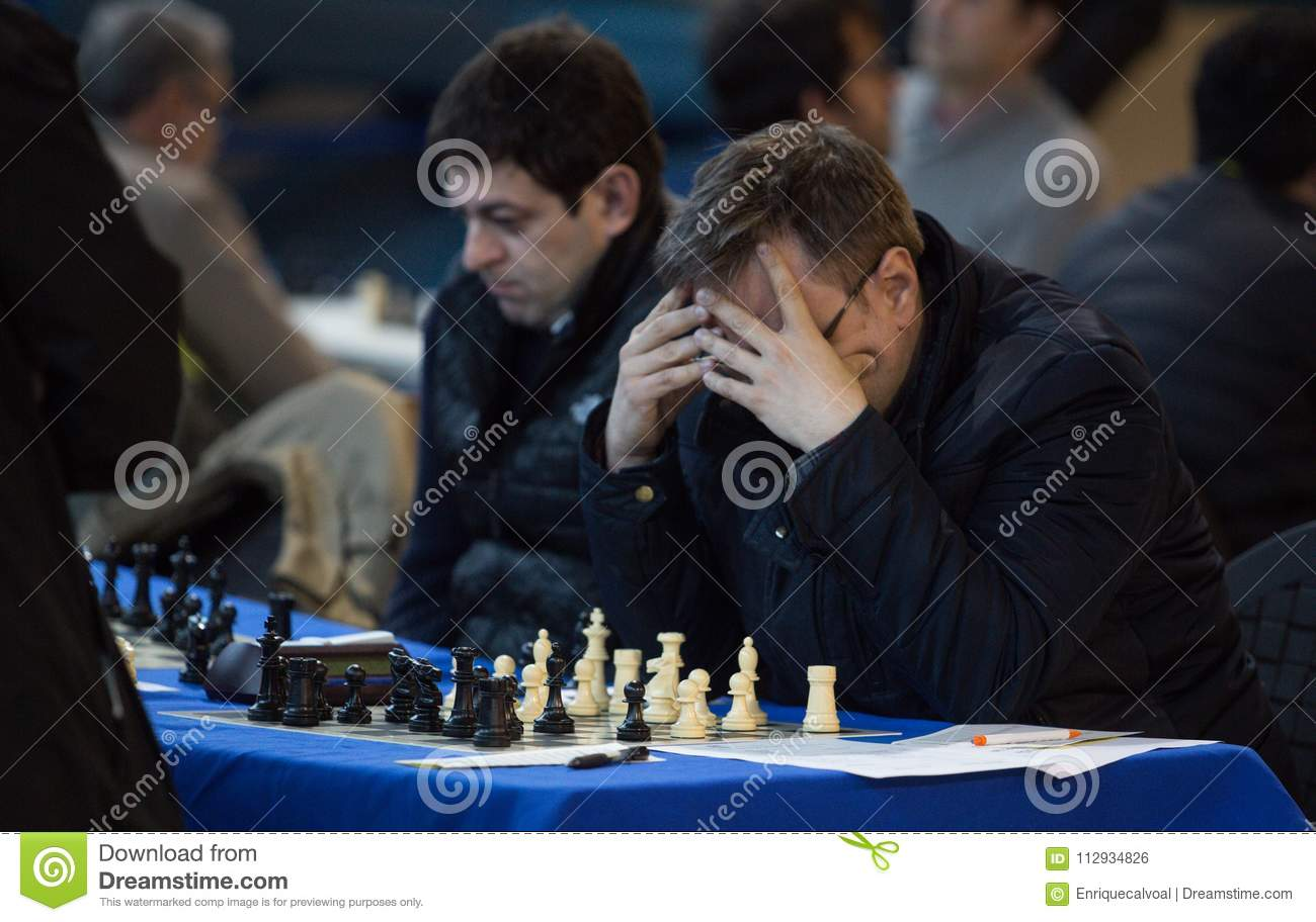 Chess Players During Gameplay At A Local Tournament Detail