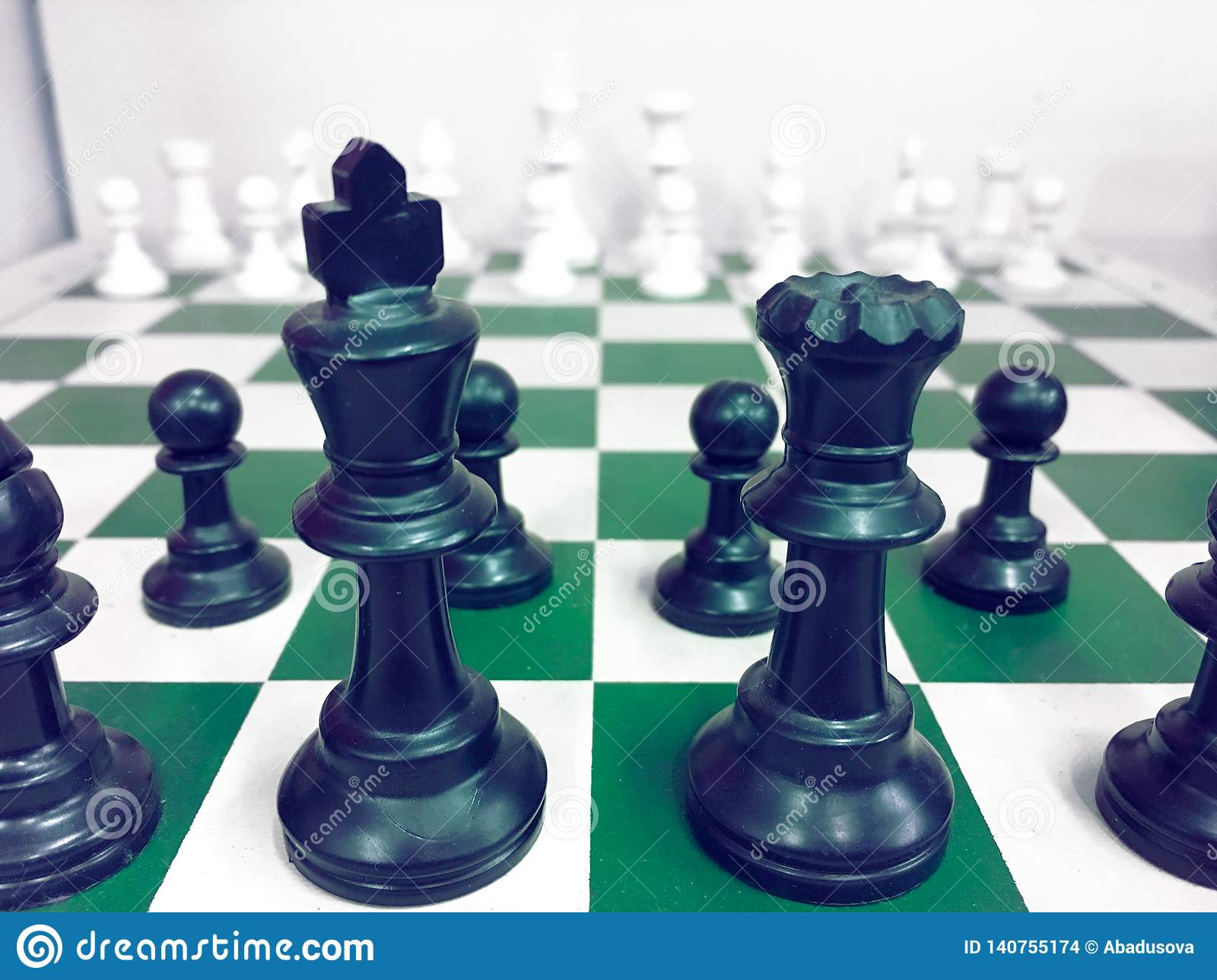 Chessboard with a chess piece on the back Negotiating in business. as background business concept and strategy concept