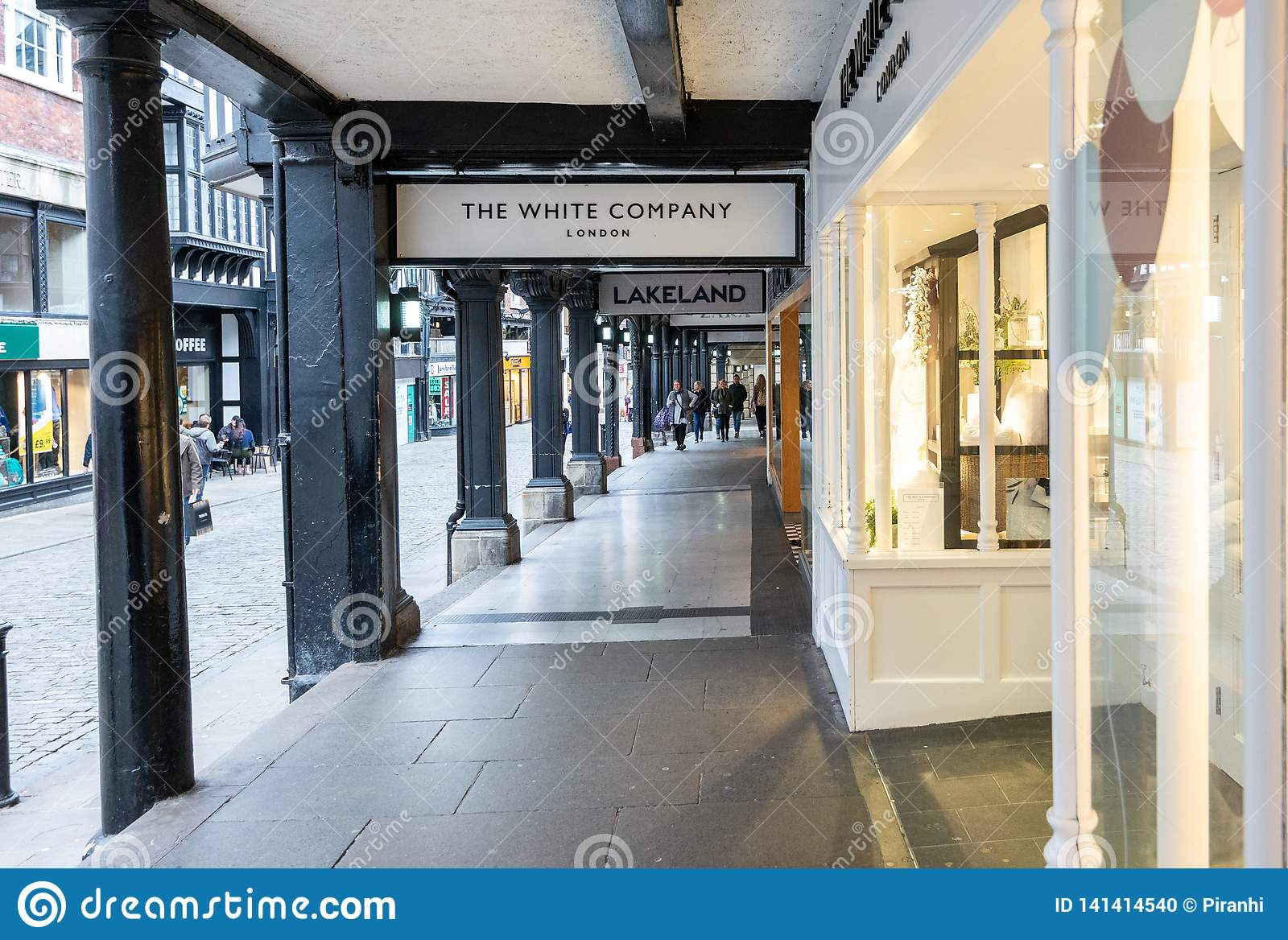 CHESTER, ENGLAND - MARCH 8TH, 2019: A view of highstreet shops in the Rows, Chester