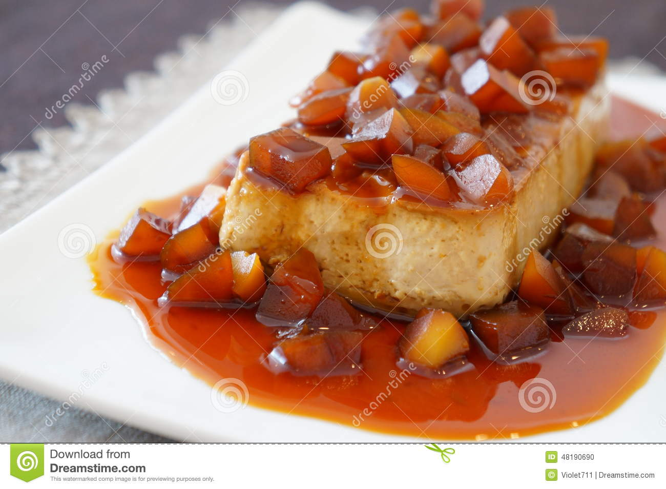 Chestnut flan with caramel sauce on a white plate.