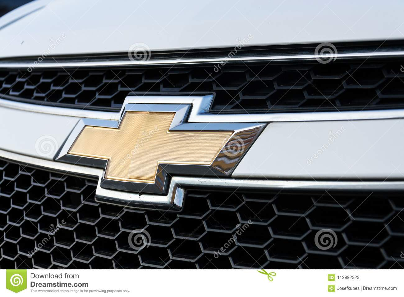 Chevrolet Division of General Motors Company logo on silver car