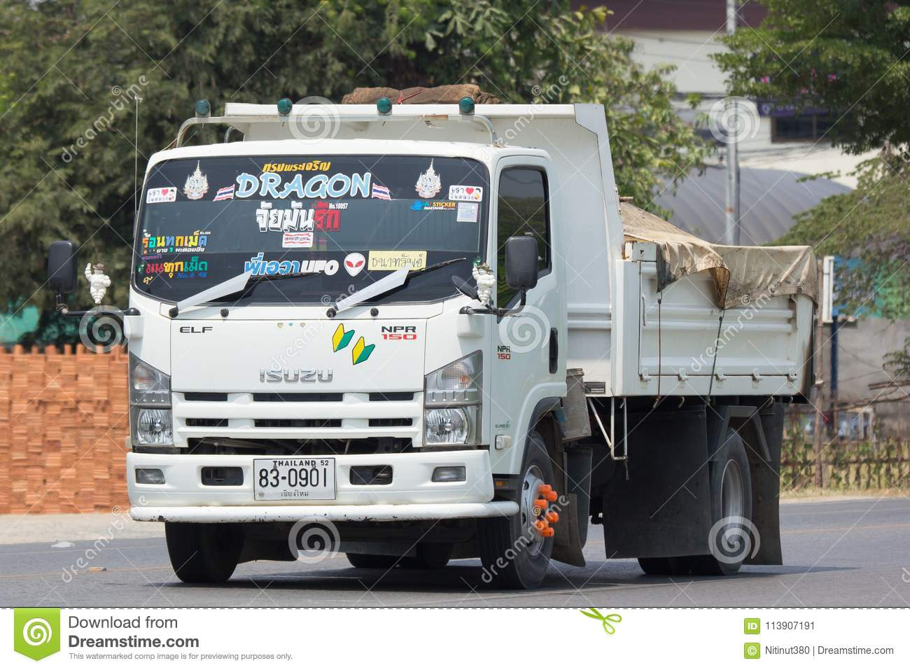 Chiang mai thailand april 5 2018 private isuzu dump truck on road no 1001 8 km from chiangmai business area