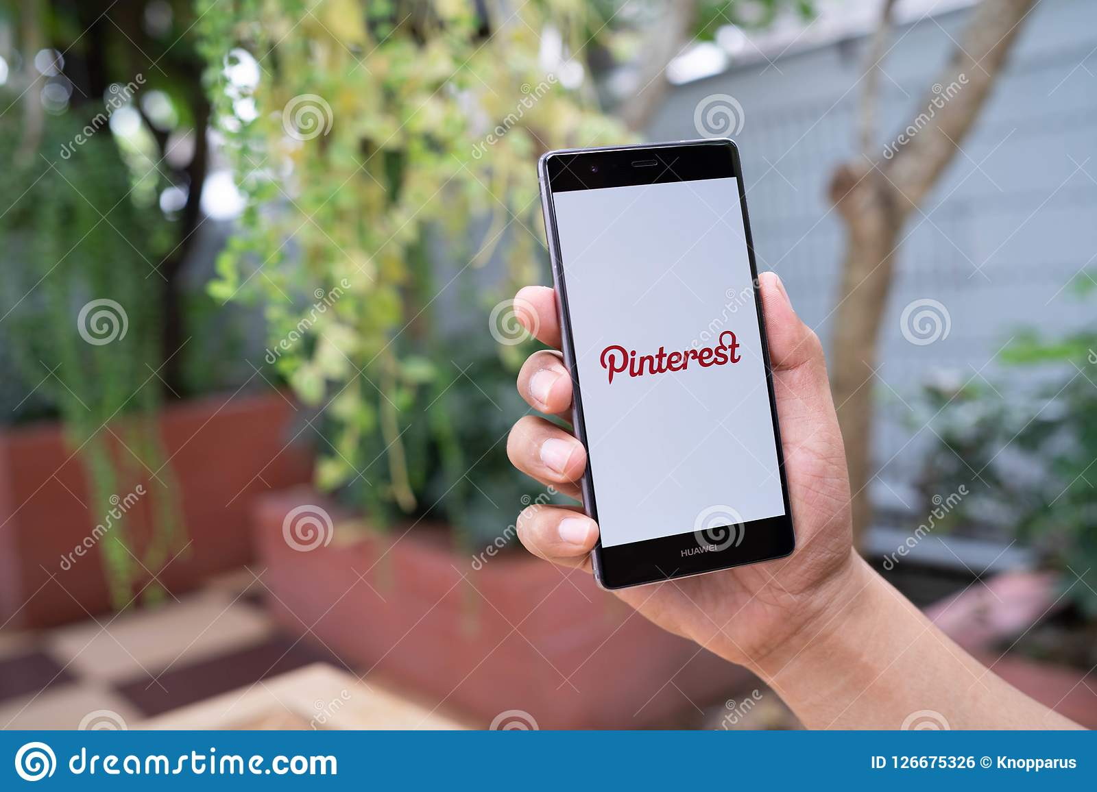 CHIANG MAI, THAILAND - August 05,2018: Man Holding HUAWEI Mobile