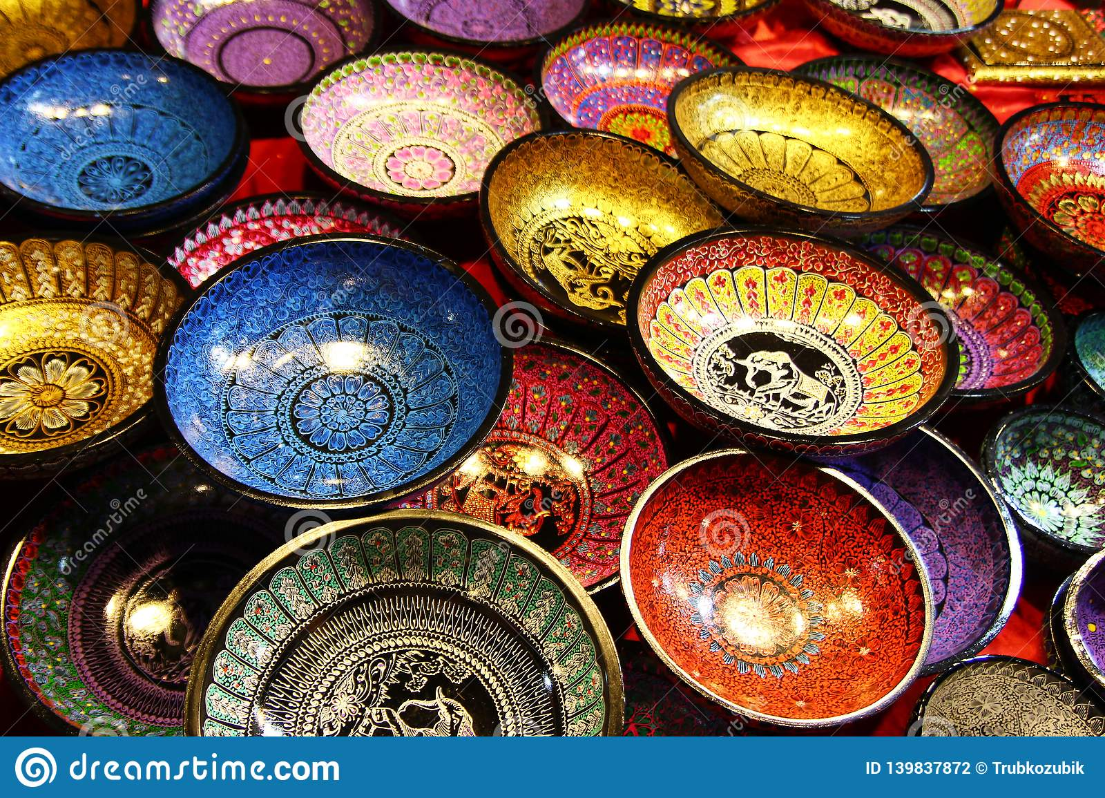 Chiang Mai, Thailand - December 2, 2017: Painted colorful wooden plates with traditional Thai design.