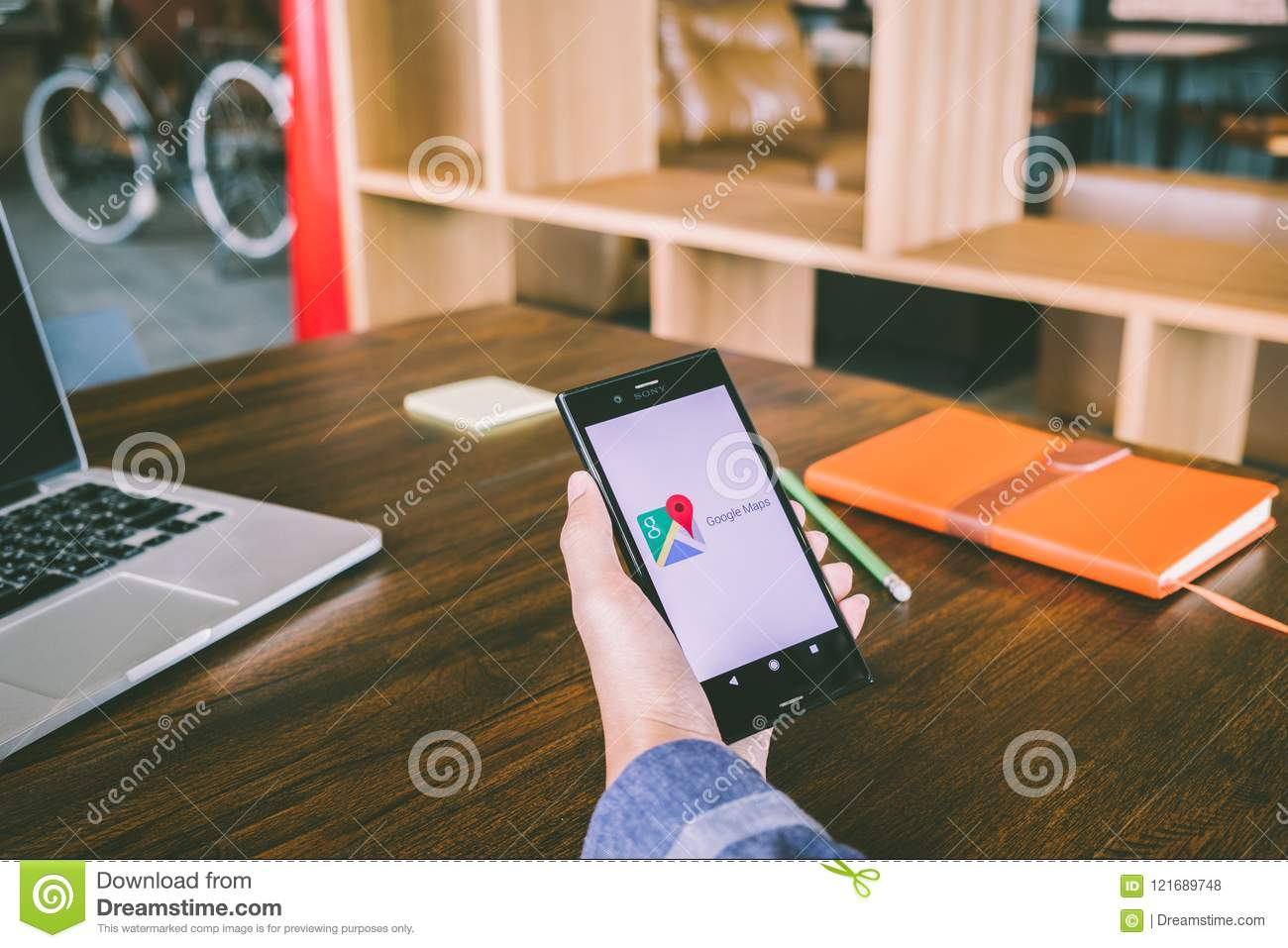 CHIANG MAI,THAILAND - July 7,2018: Man Holds Mobile Phone ... on windows 8.1 download for laptop, bbm download for laptop, minecraft download for laptop,