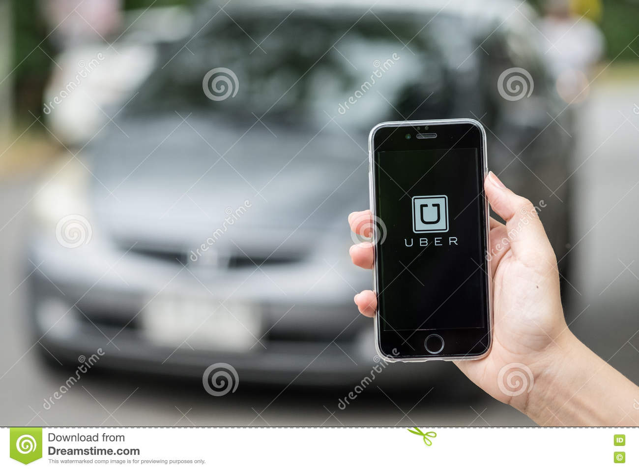 CHIANG MAI,THAILAND - JULY 24,2016 : A woman hand holding Uber a