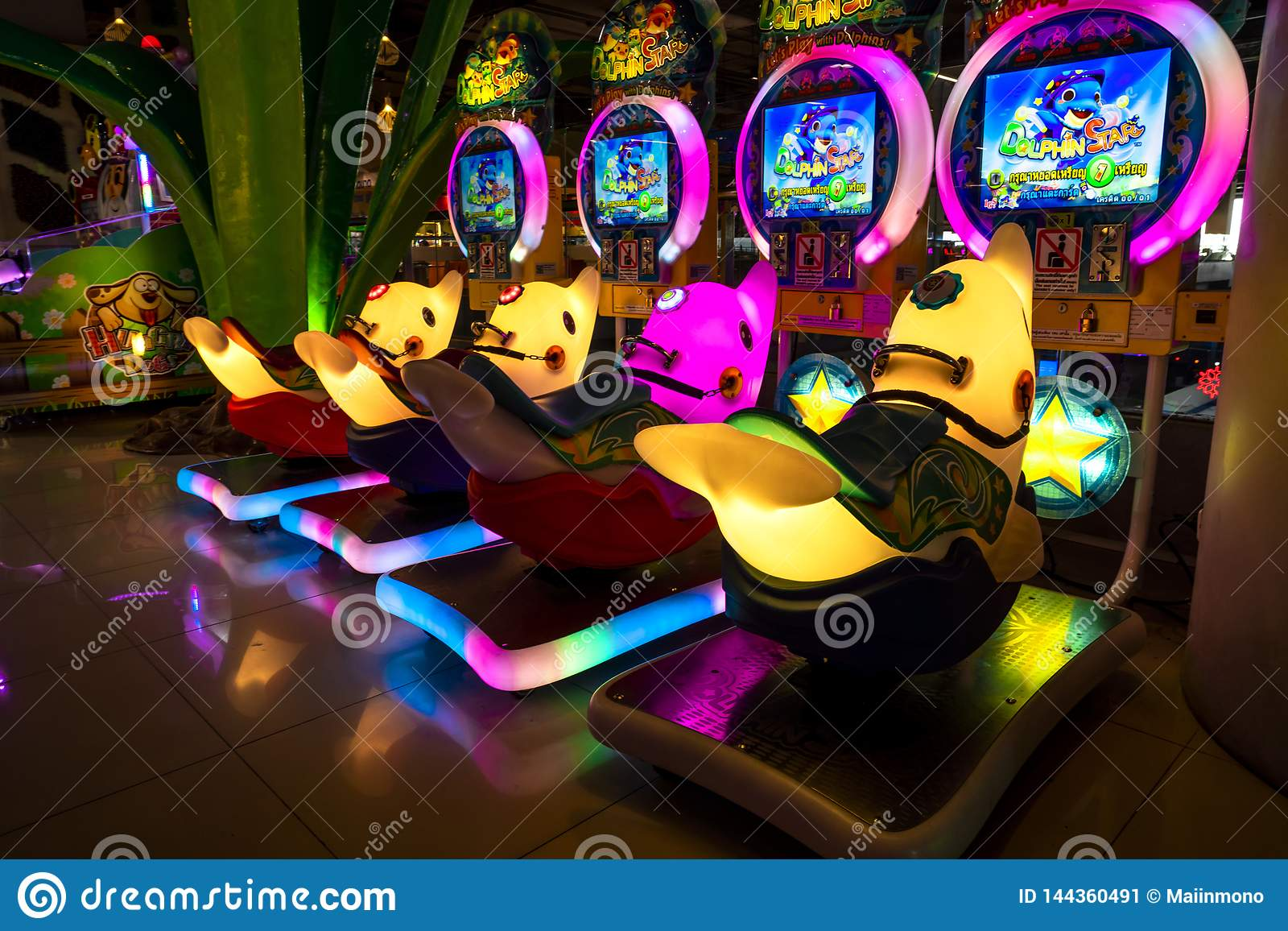 Chiang Mai / Thailand - March 12, 2019 : Colorful coin-operated game cabinet with neon light at Central Festival Department Store.