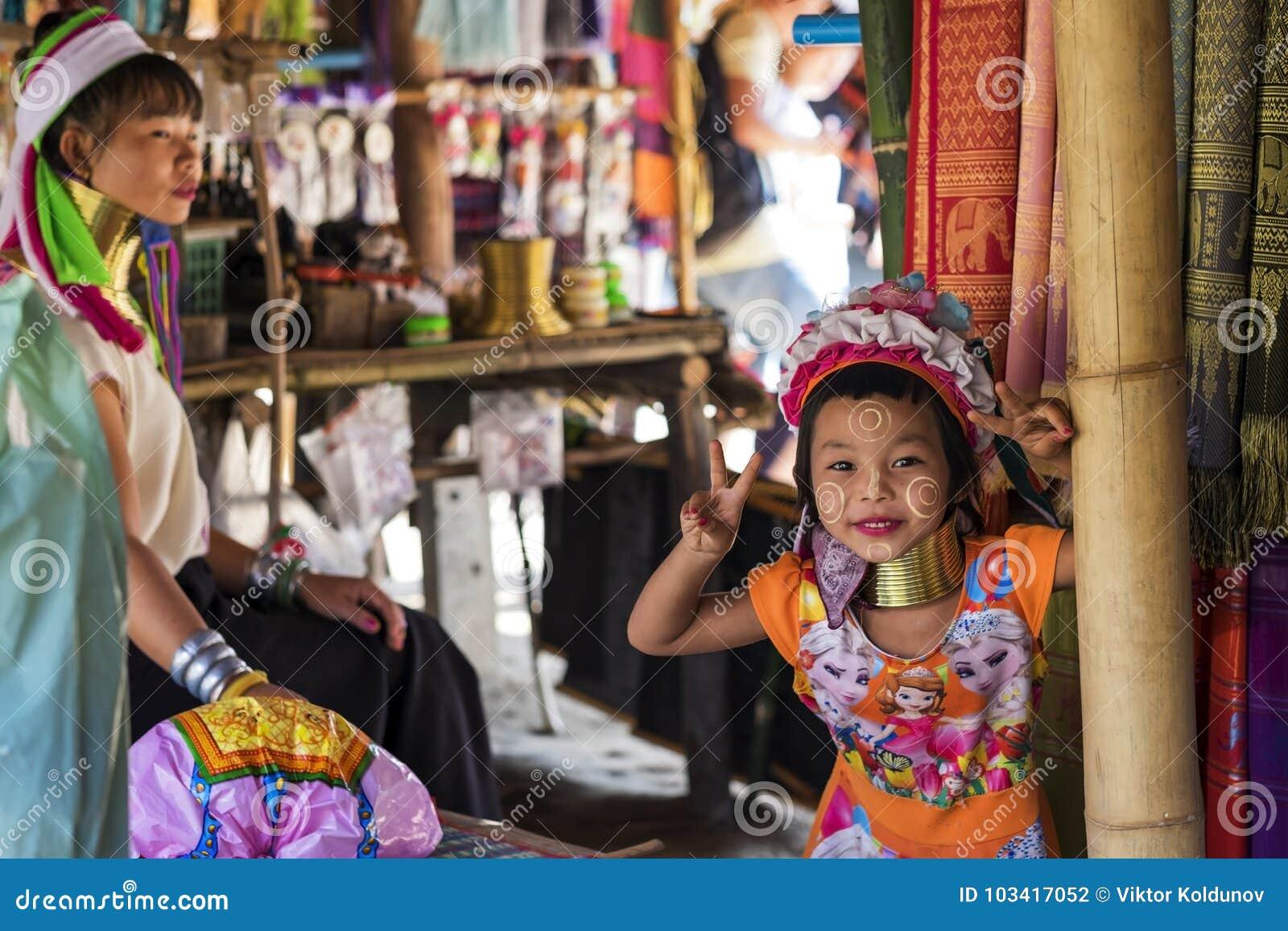 CHIANG RAI, THAILAND - NOVEMBER 4 2017: Unidentified Long Neck Karen hill tribe girl smiling