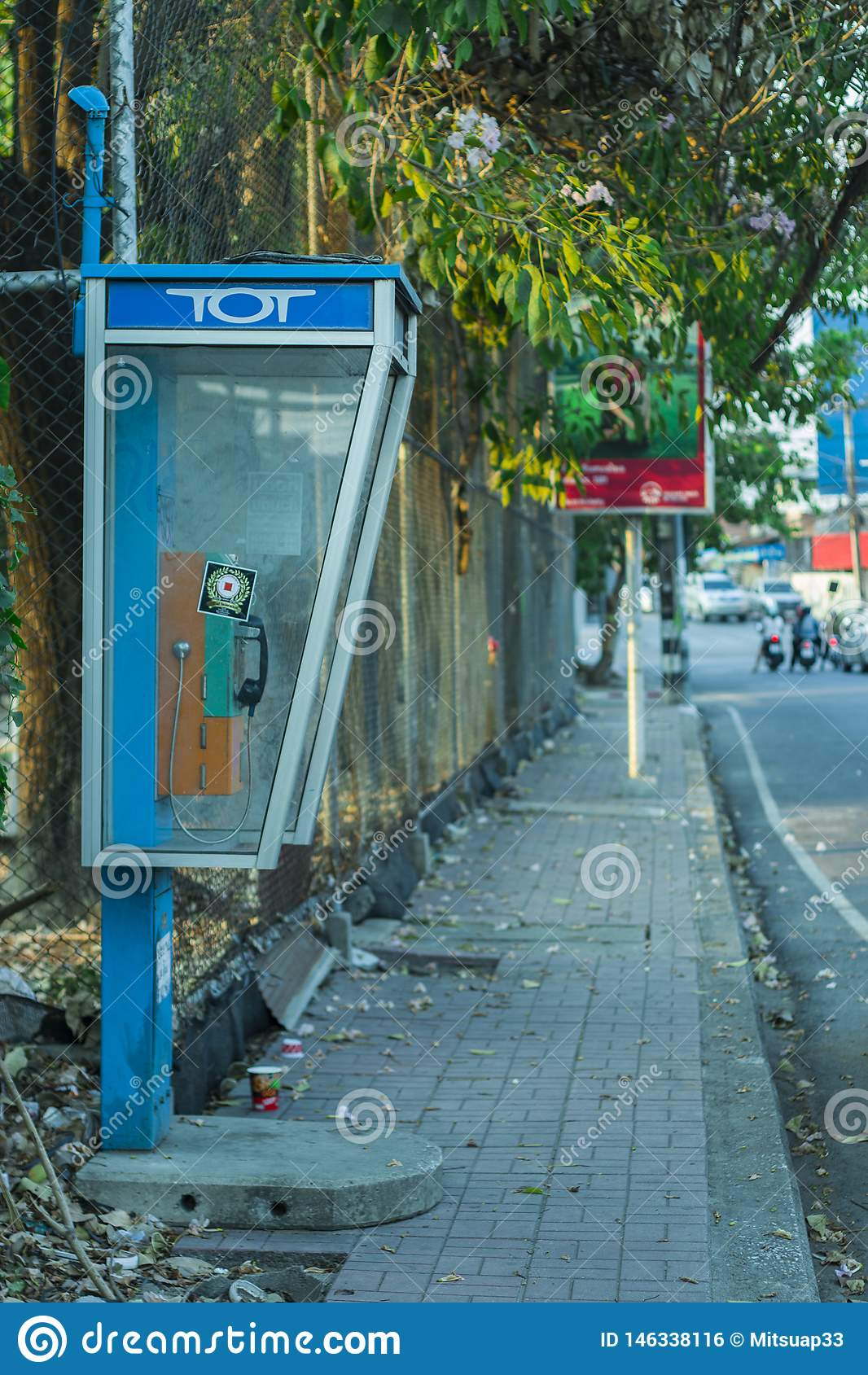 CHIANGMAI,THAILAND-APRIL 30,2019 : Old Public telephones at side walk but no customers use the service because people tend to use