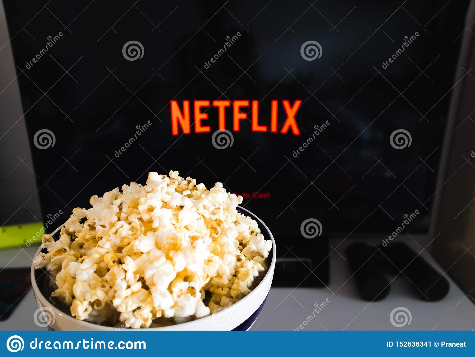 CHIANGMAI, THAILAND - JULY 7, 2019- Popcorn bowl and Netflix logo on Smart TV