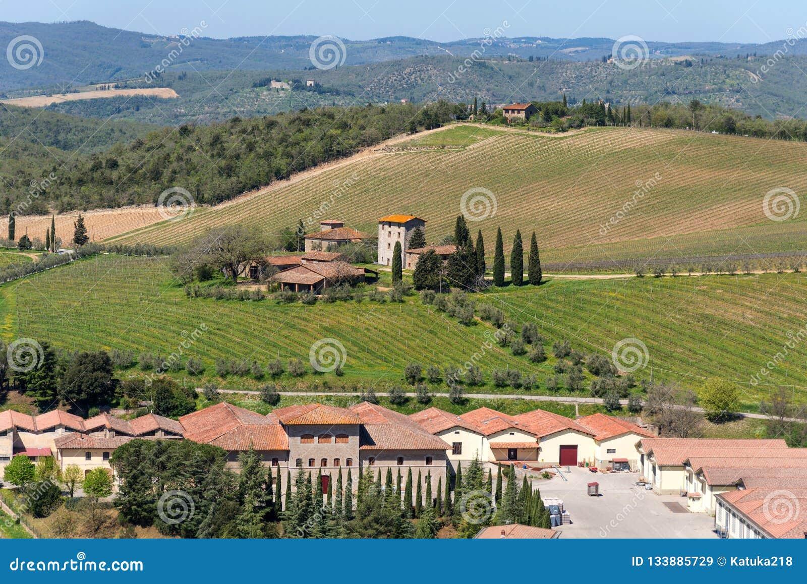 Chianti Region, Italy - April 21, 2018: Farmland rural landscape, cypress trees, vineyards and olive trees from Castello di Brolio