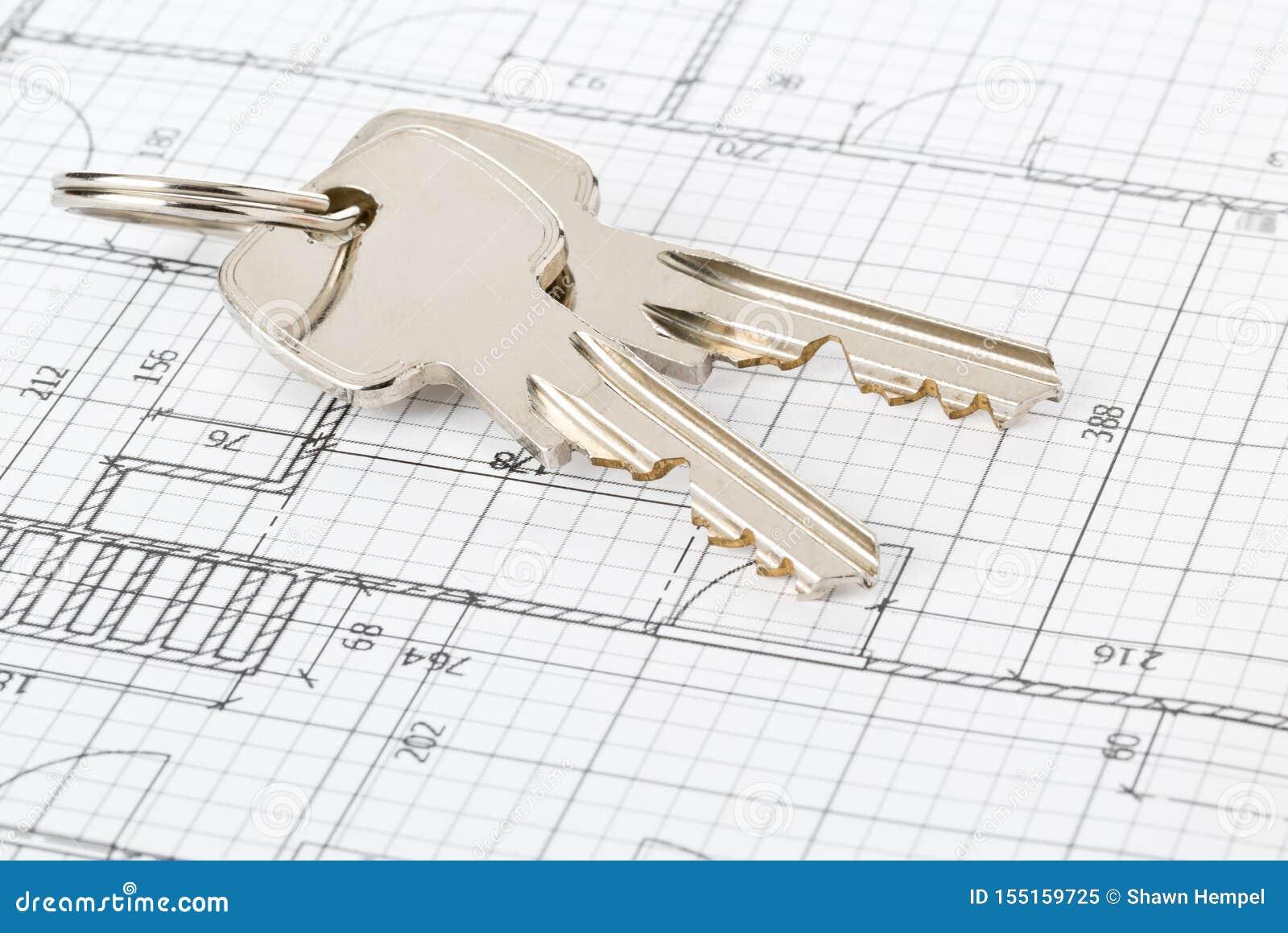Chiavi della Camera sul modello architettonico della casa - proprietario domestico, bene immobile o concetto della costruzione di