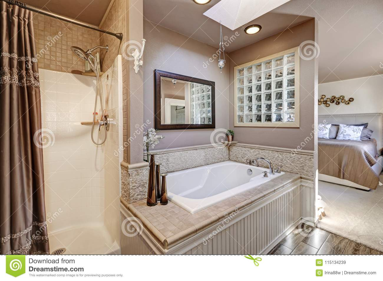 Chic Bathroom With Modern Spa Like Drop In Tub Natural Stone Tile Surround And Shower Brown Curtain Northwest USA