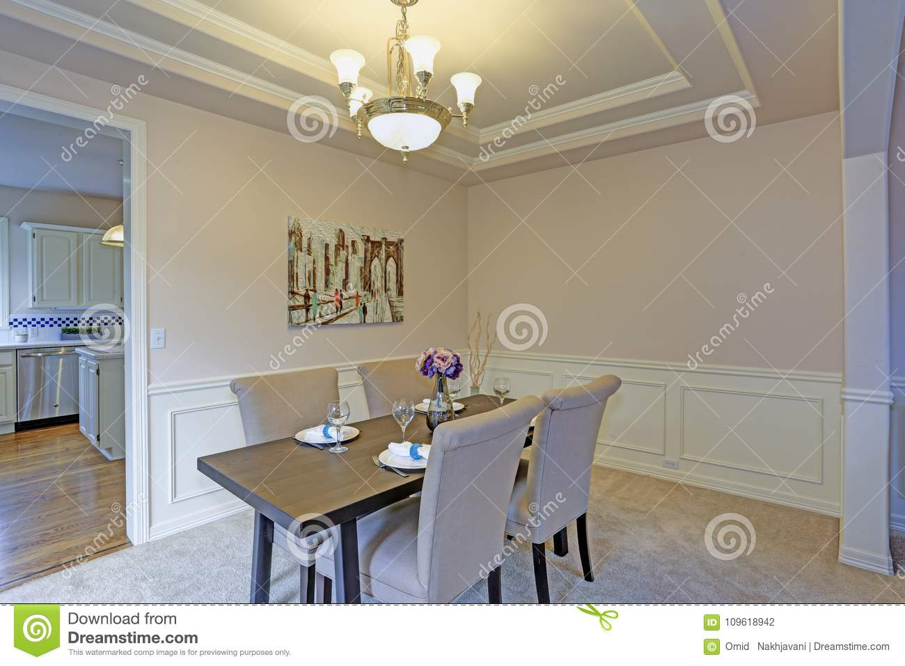 Chic Dining Room Accented With Wall Panel Mouldings And Tray Ceiling Stock Photo Image Of Estate Family 109618942