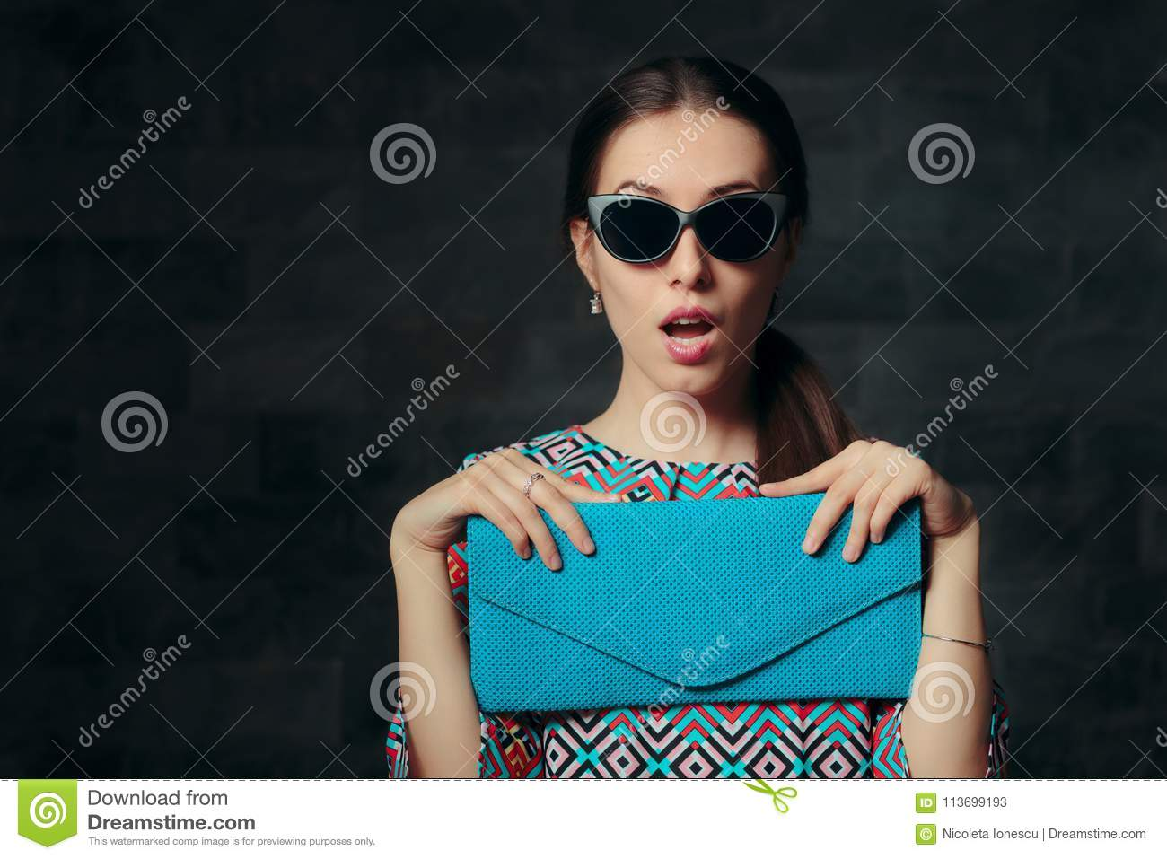 Elegant Woman with Retro Cat Eye Sunglasses and Clutch Purse