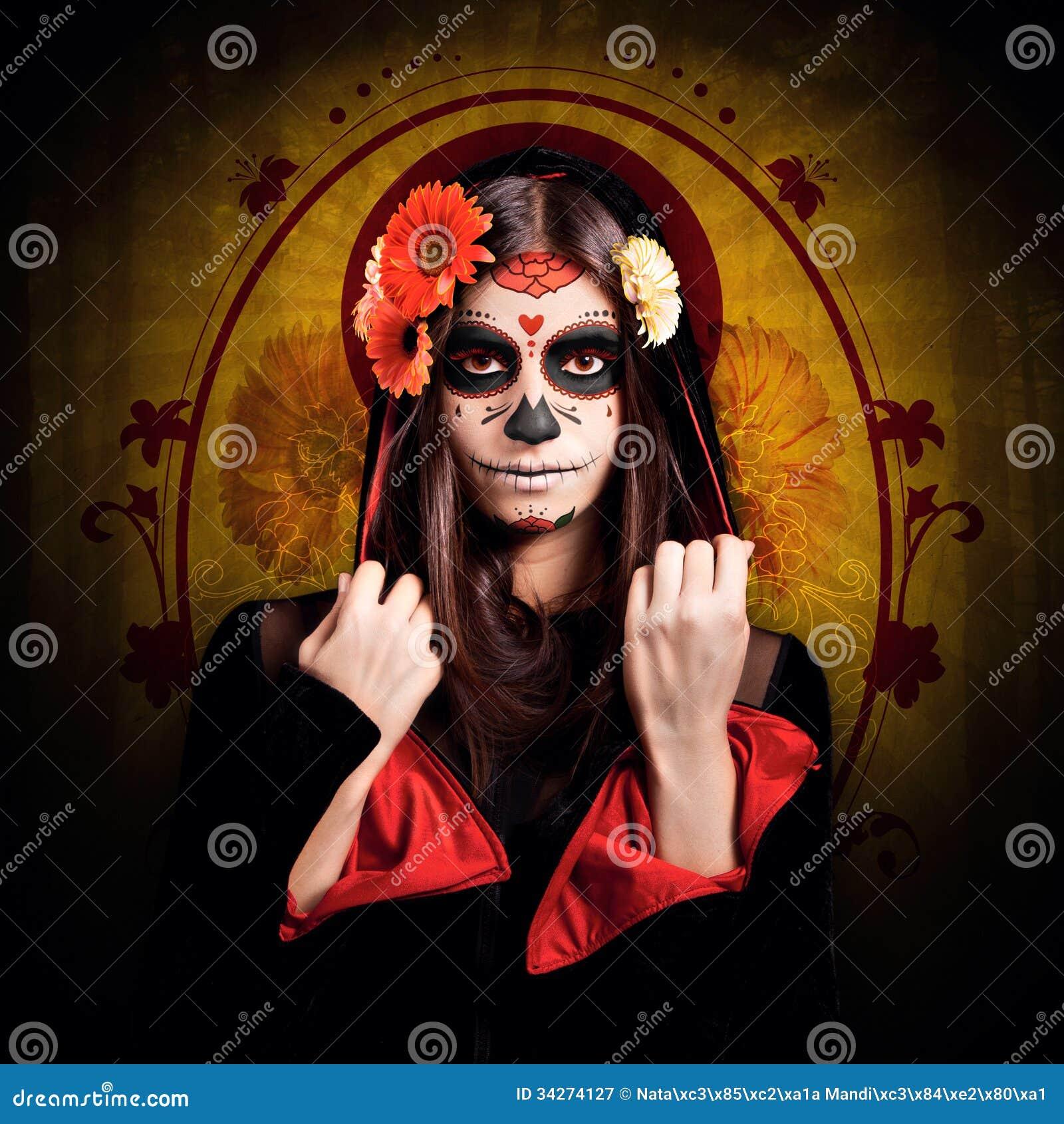Chica joven con el maquillaje de Halloween