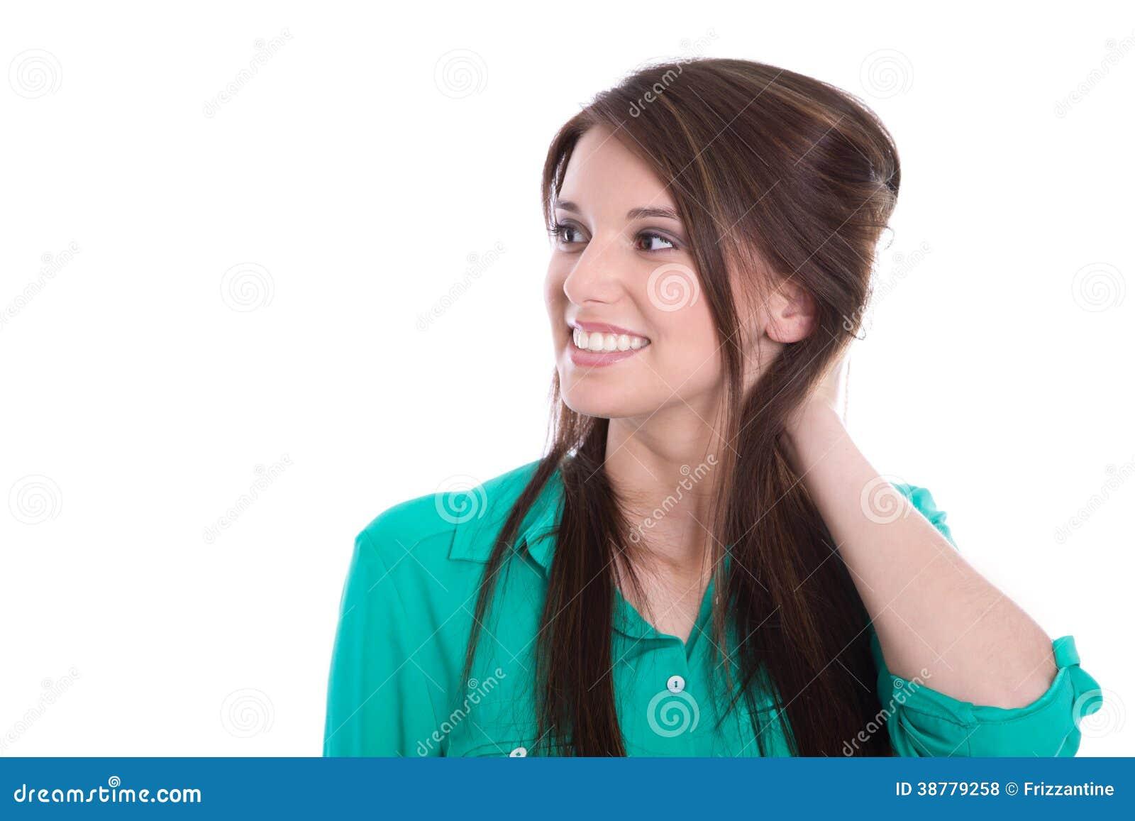 Chica joven feliz en verde aislada en blanco.