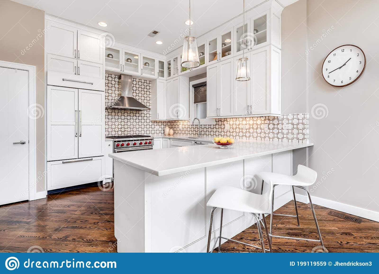 A Luxury White Kitchen With A Unique Tile Backsplash Editorial Stock Image Image Of Chair Elegance 199119559