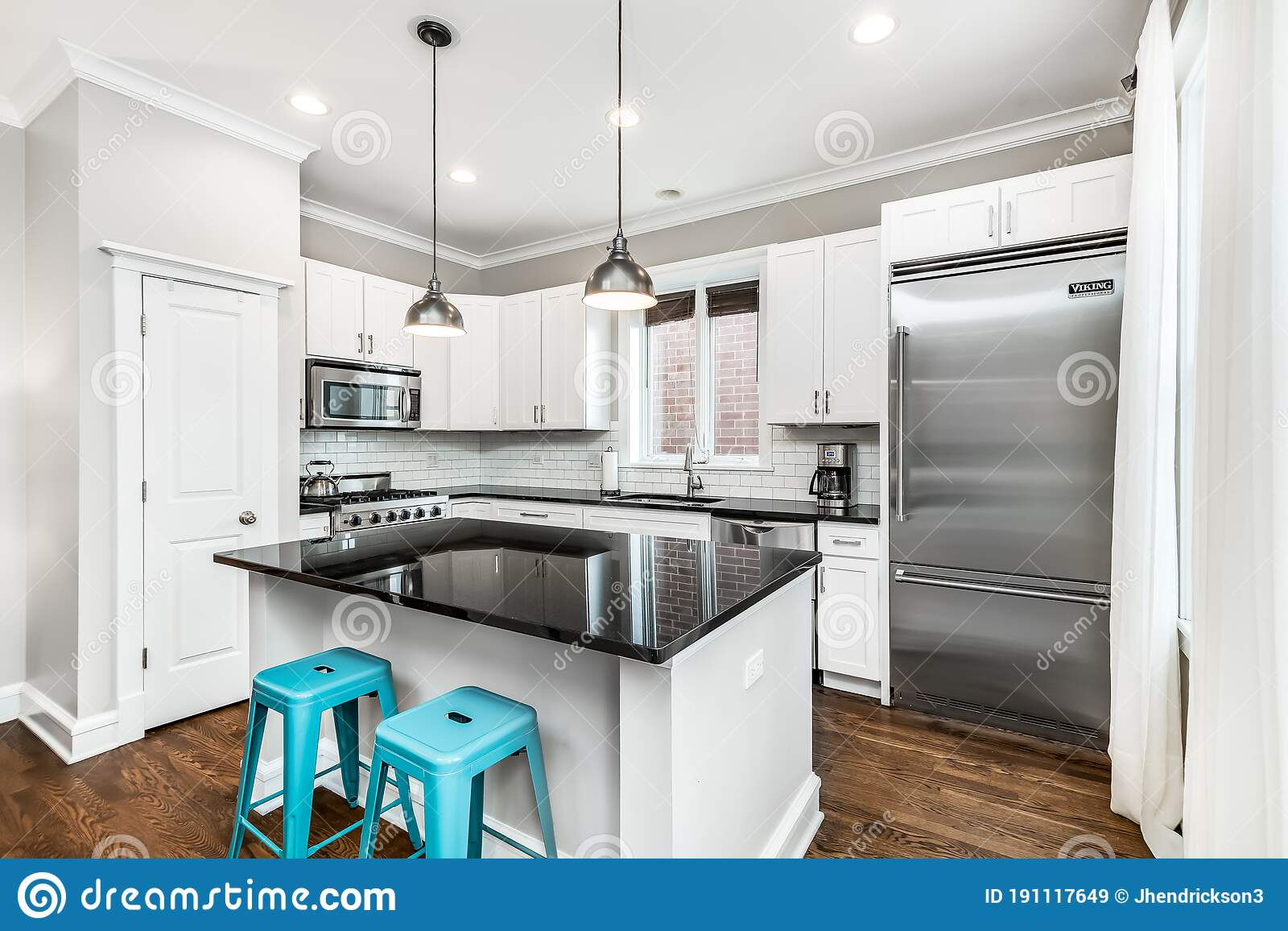 Picture of: White Kitchen With Blue Bar Stools Stock Image Image Of Design Interior 191117649