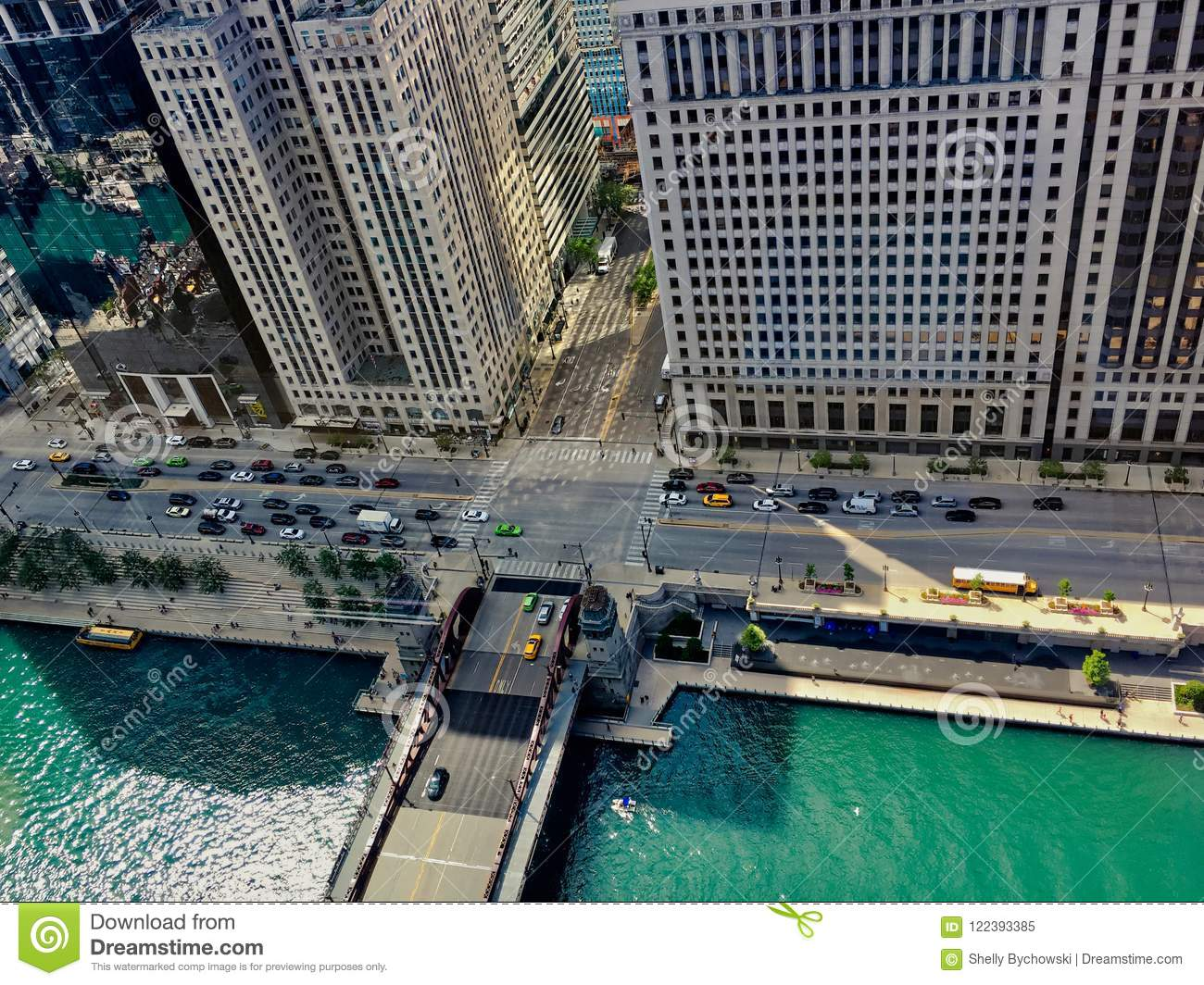 High angle view of summer in Chicago, including Chicago River, school bus, Wacker Drive, shadows cast off of buildings, etc