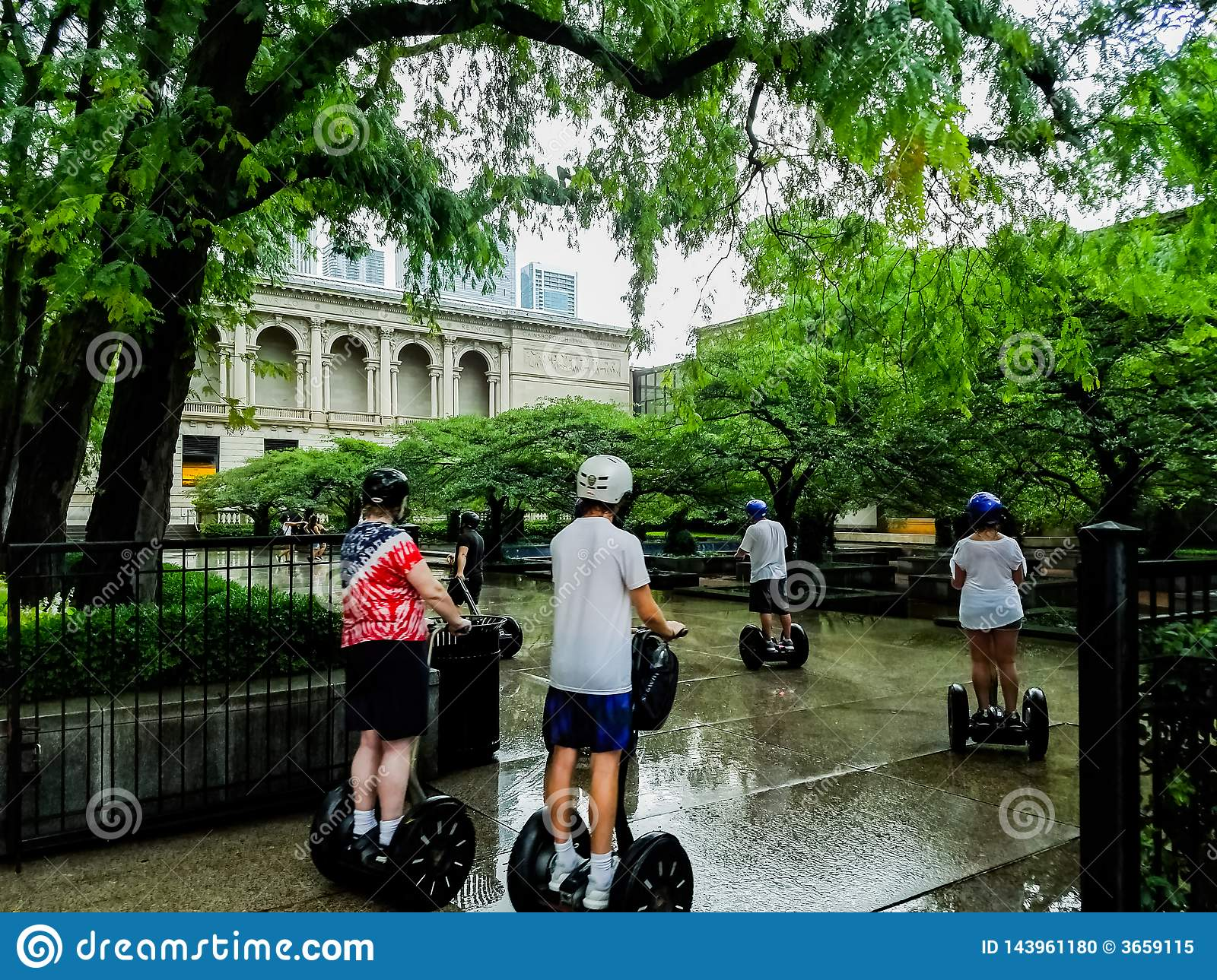 Chicago, Illinois, USA. 07 07 2018. Group of tourists on segways tour in the park near museum