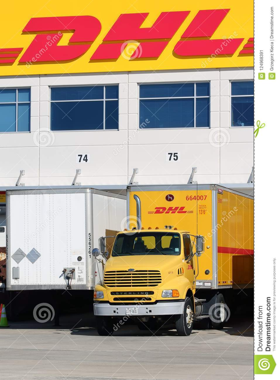 DHL Truck And Trailer Parked At A Warehouse Editorial Photo