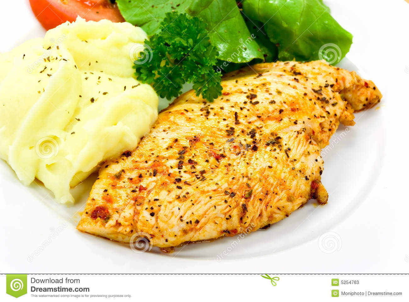 Chicken Breast - Marinated And Baked,with Salad Stock Photos - Image ...